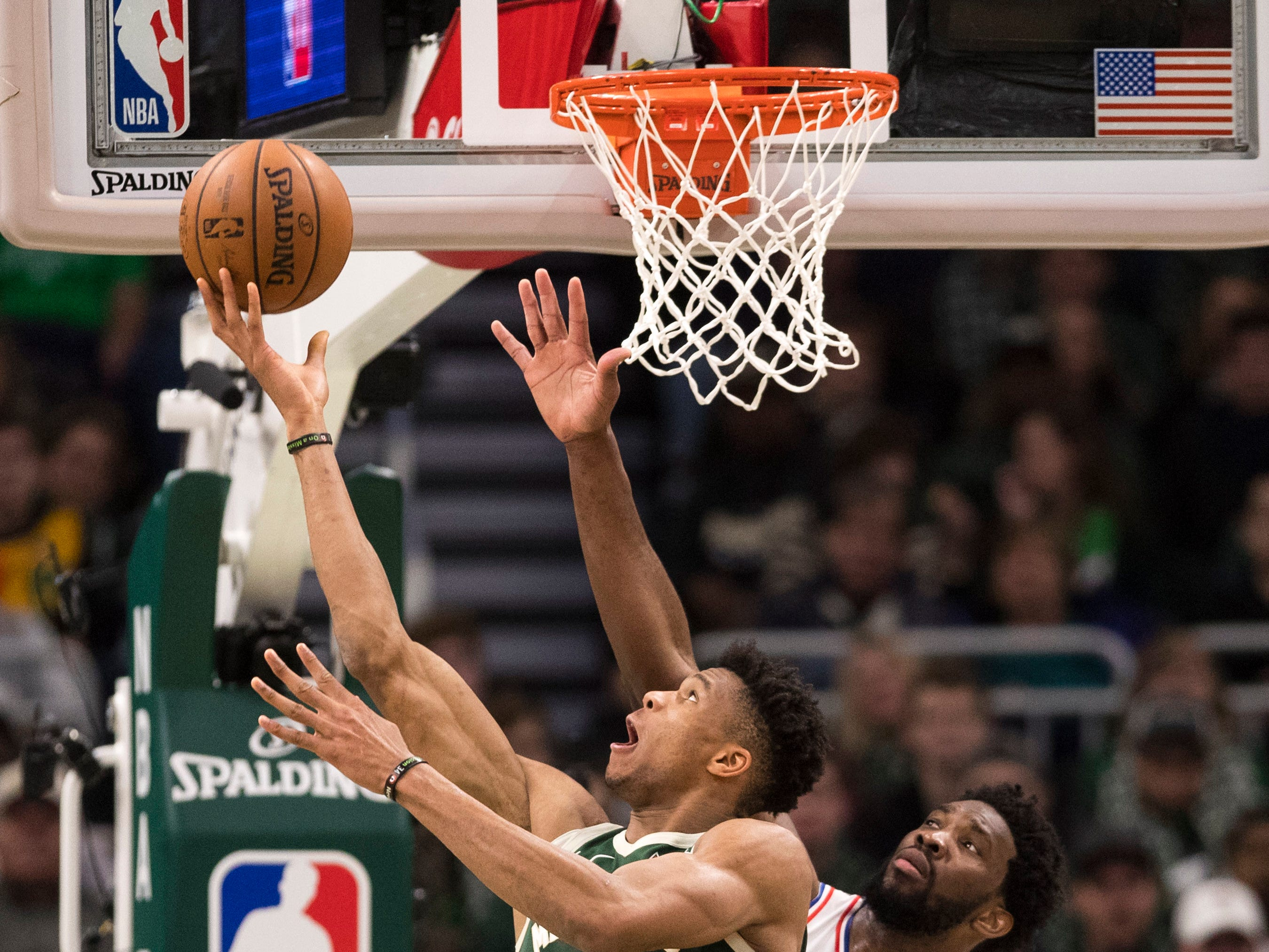 Bucks forward Giannis Antetokounmpo puts up a shot against the 76ers during the fourth quarter.