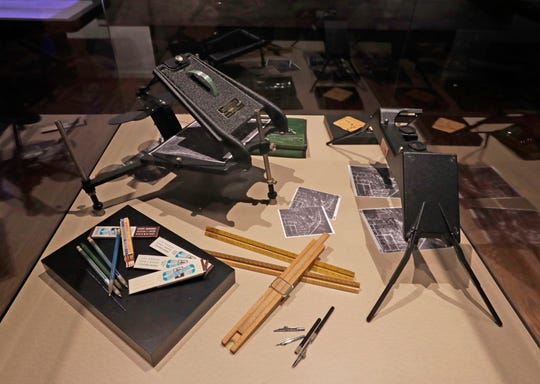 "A display case at the Wisconsin Veterans Museum's exhibit ""In My Spare Moments: The Art of Harold F. Schmitz"" features mapmaking tools similar to those used by soldiers during World War II. Schmitz was a Milwaukee commercial artist when he was drafted into the Army's 955th Topographic Engineer Co. to create maps in the Pacific."
