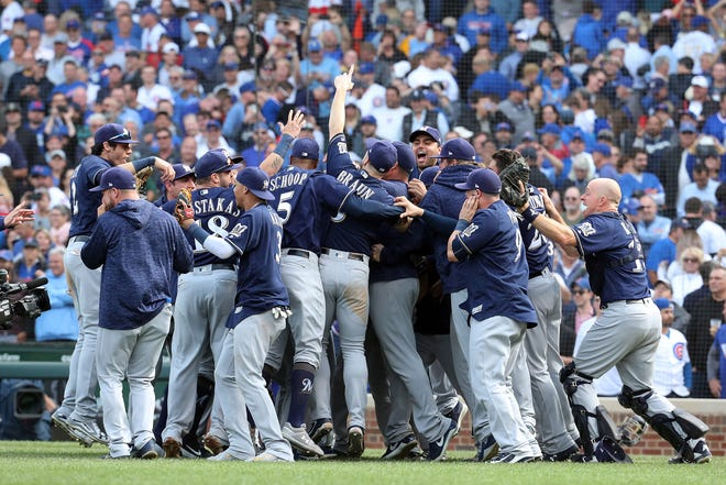 The Brewers celebrate their 3-1 victory over the Cubs in the  Game 163 tiebreaker for the 2018 NL Central title.