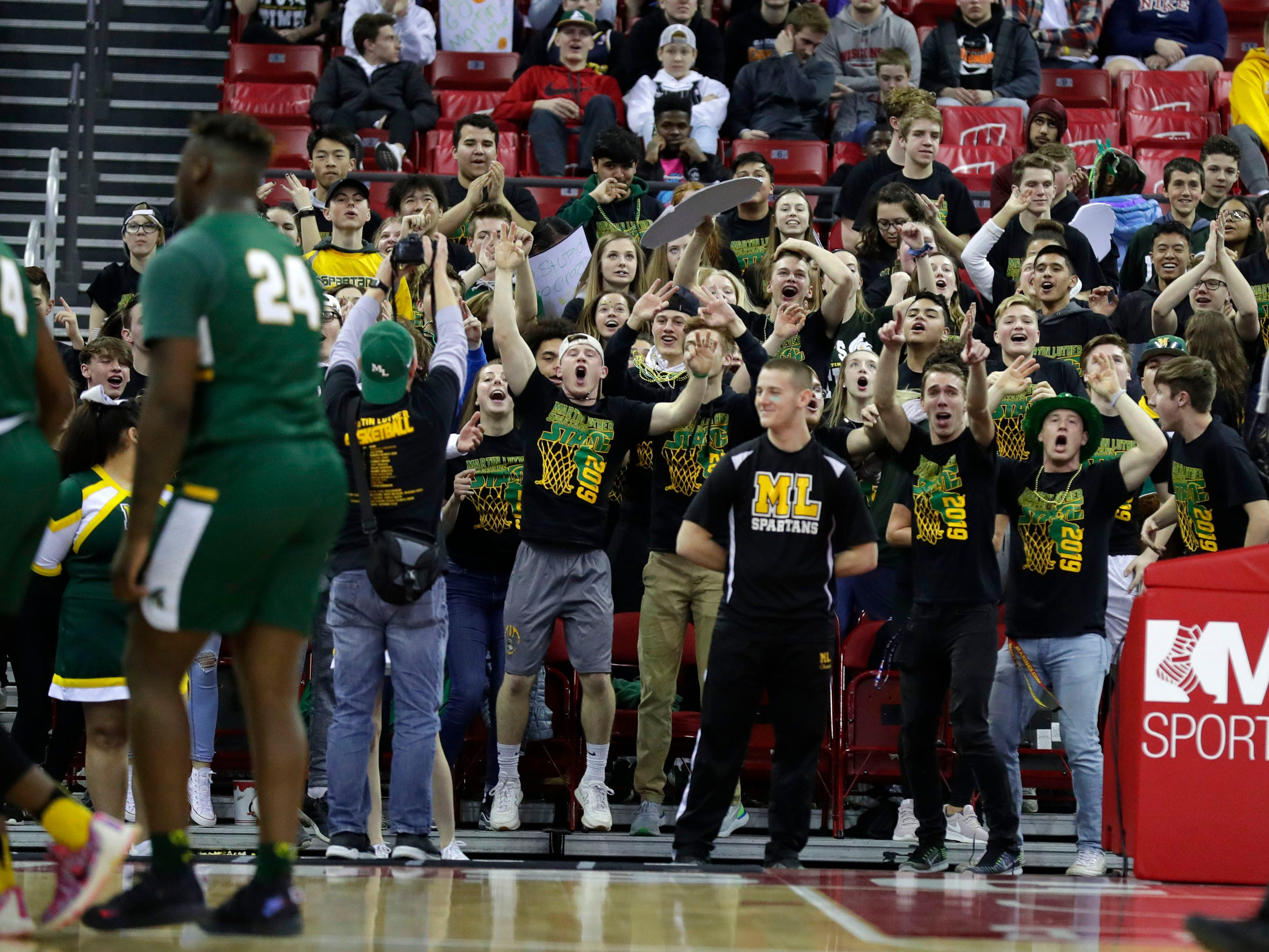 Martin Luther students cheer their team on during the Spartans' Division 3 championship game against Waupun on Saturday.