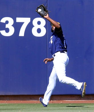 31b5abcd8 Brewers centerfielder Lorenzo Cain makes a running catch near the warning  track against the Rockies on