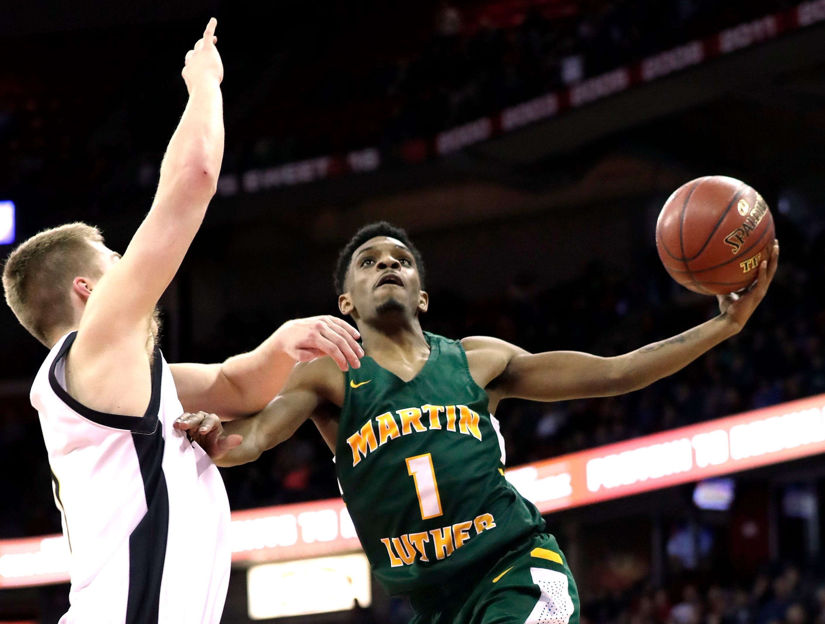 Martin Luther's Trequan Carrington is fouled driving to the basket by Waupun's Marcus Domask during the  D3 championship game at the WIAA 2019 Boys State Basketball Tournament in Madison, Wisconsin, Saturday, March 16, 2019.  Rick Wood/Milwaukee Journal Sentinel