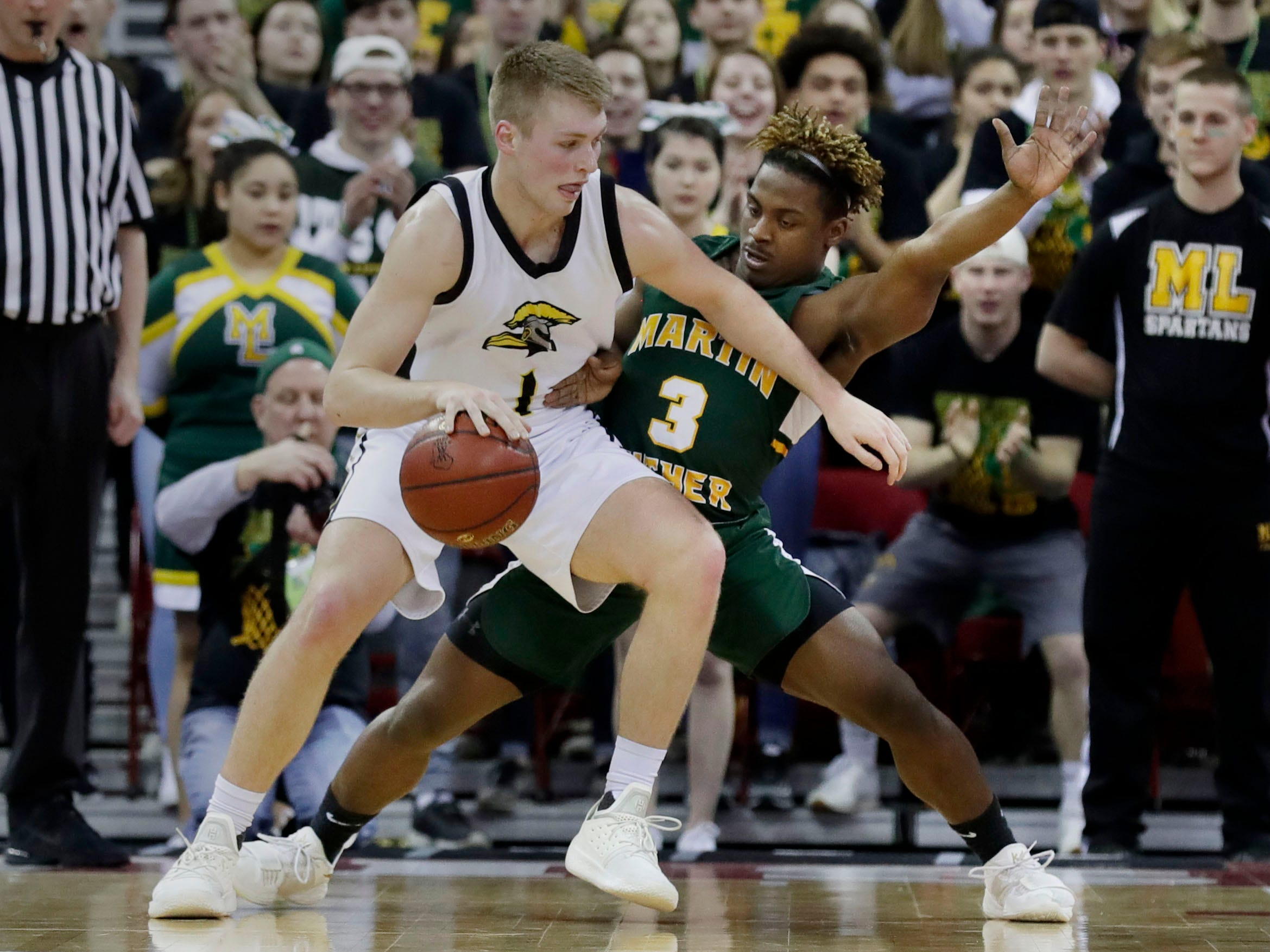 Waupun's Marcus Domask, who was named the Mr. Basketball  by the Wisconsin Basketball Coaches Association on Saturday, works against Martin Luther's Darios Crawley-Reid during the  Division 3 championship game.