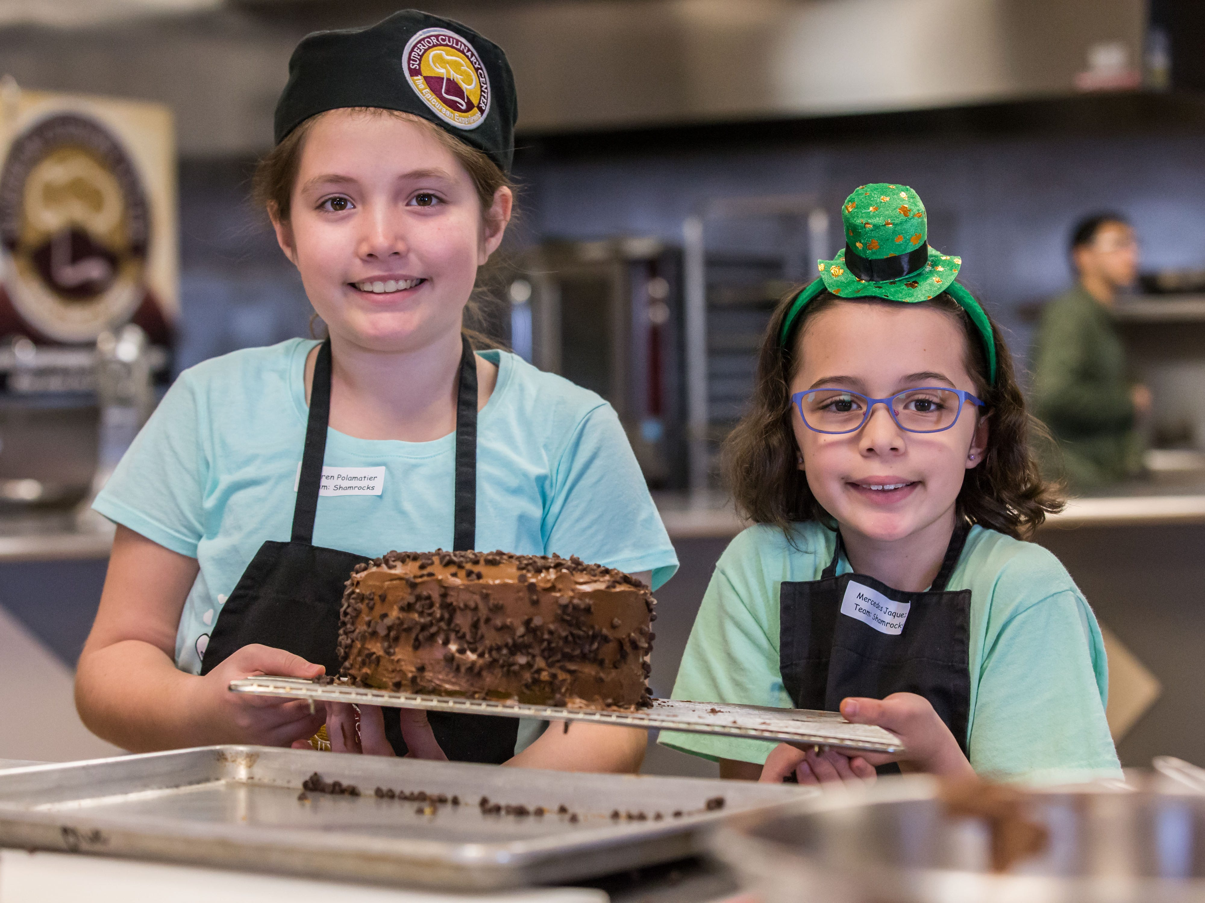 Chefs in training Lauren Polamatier (left), 10, and Mercedes Jaquez, 8, both of New Berlin, hold up a cake they created during the St. Patrick's Kids Cooking Class at Superior Culinary Center in Saint Francis on Saturday, March 16, 2019. Visit superiorculinarycenter.com for info on upcoming classes.