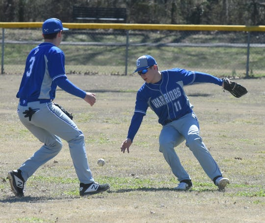 A pop-up falls in between Cotter's Cole Stevenson (11) and Tucker Coots during action at the Big Cat Classic at Yellville City Park.