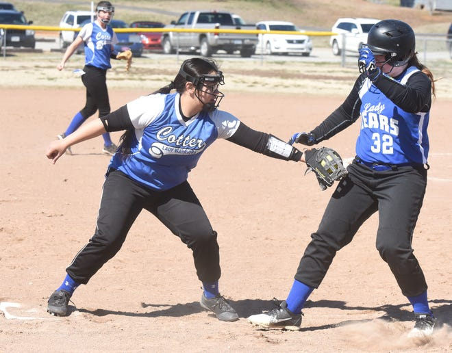 Cotter's Ashley Garay tags Mammoth Spring's Kelli Young on Saturday in the Big Cat Classic at Yellville.