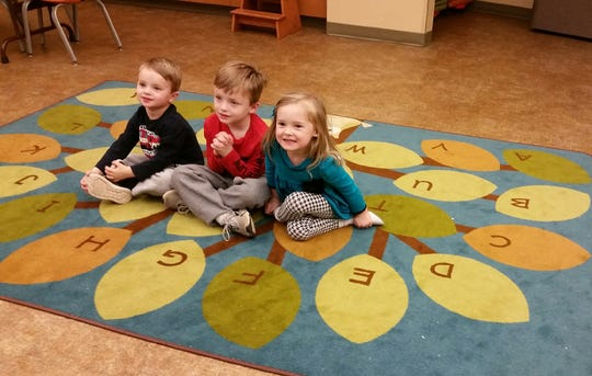 Jackson Dover, Luke Dover and Garnet Simmons are the most recent graduates of the 1,000 Books Before Kindergarten at the Donald W. Reynolds Library Serving Baxter County.