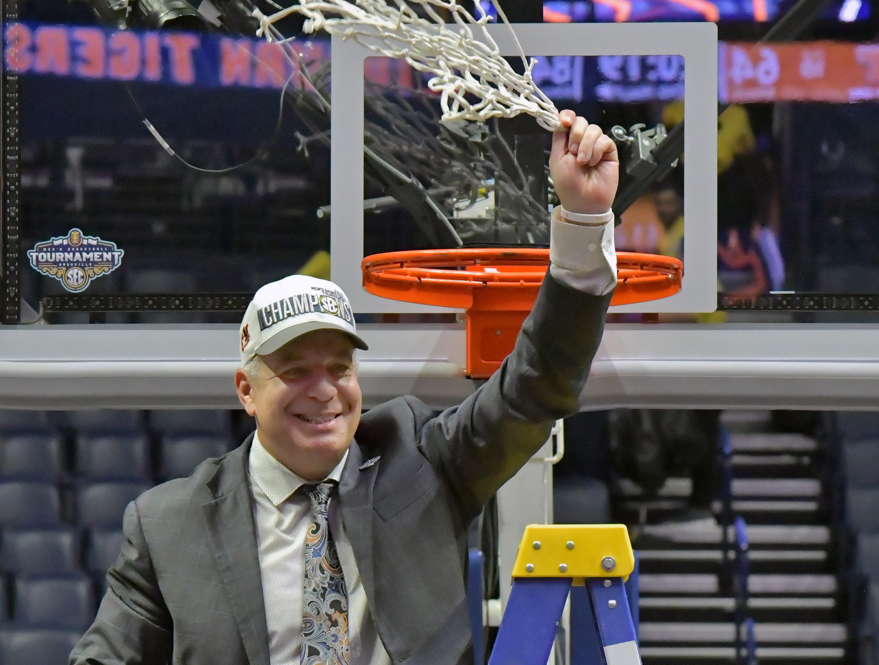 Mar 17, 2019; Nashville, TN, USA; Auburn Tigers head coach Bruce Pearl cuts down the net and waves toward fans following the championship game between the Tennessee Volunteers and the Auburn Tigers  in the SEC conference tournament at Bridgestone Arena. Auburn won 84-64. Mandatory Credit: Jim Brown-USA TODAY Sports