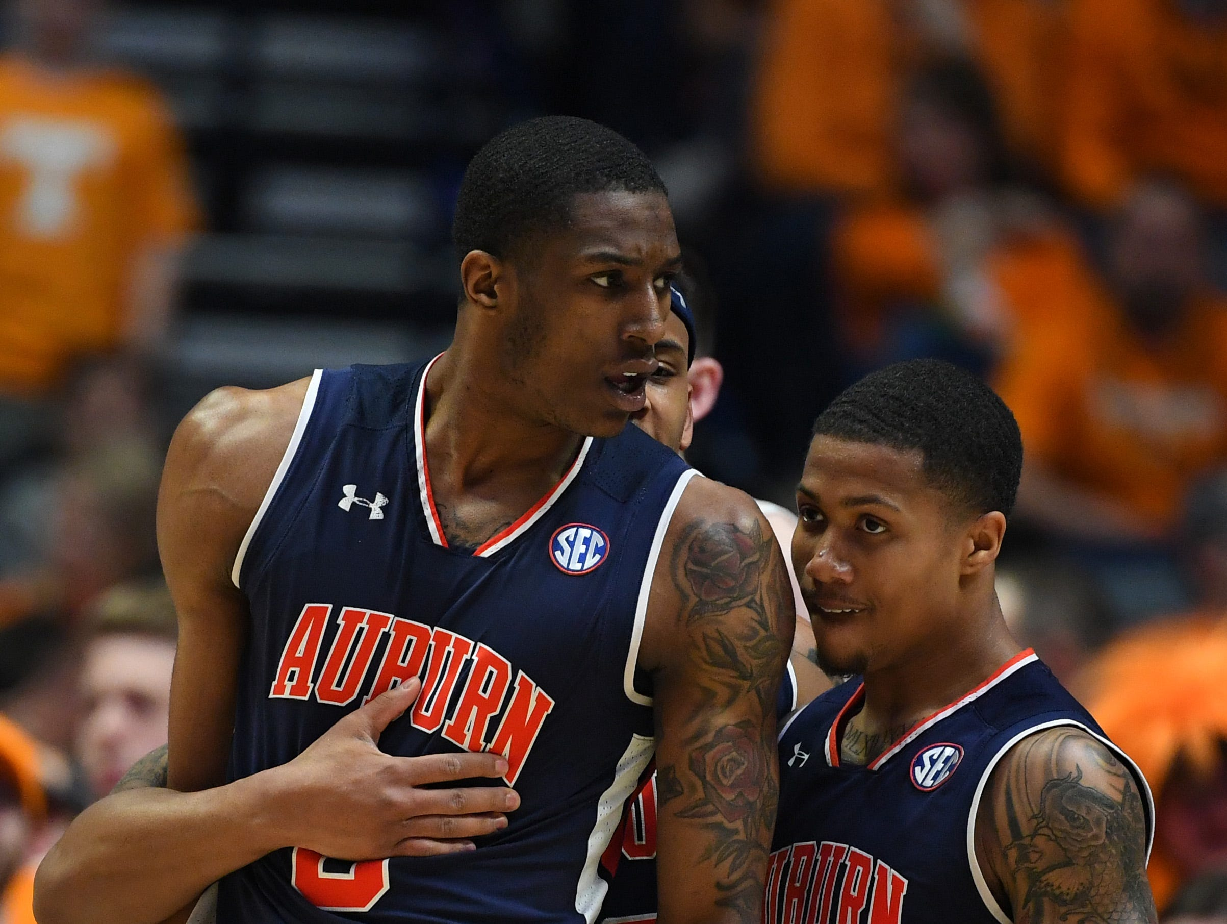 Mar 17, 2019; Nashville, TN, USA; Auburn Tigers forward Horace Spencer (0) and Auburn Tigers guard J'Von McCormick (12) after a foul against the Tennessee Volunteers during the first half in the SEC conference tournament championship game at Bridgestone Arena. Mandatory Credit: Christopher Hanewinckel-USA TODAY Sports