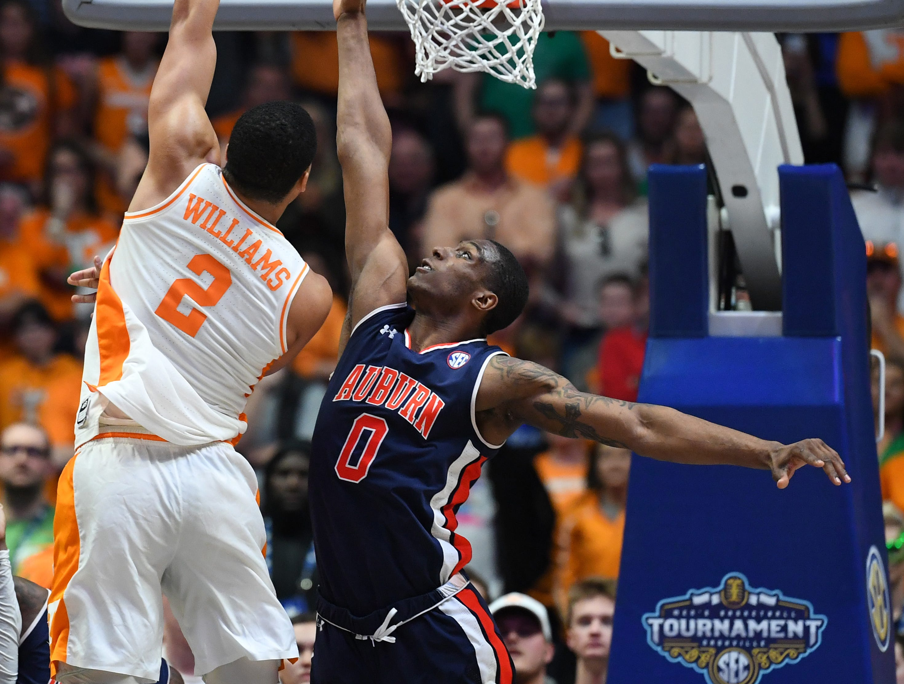 Mar 17, 2019; Nashville, TN, USA; Tennessee Volunteers forward Grant Williams (2) shoots over Auburn Tigers forward Horace Spencer (0) during the second half in the SEC conference tournament championship game at Bridgestone Arena. Mandatory Credit: Christopher Hanewinckel-USA TODAY Sports