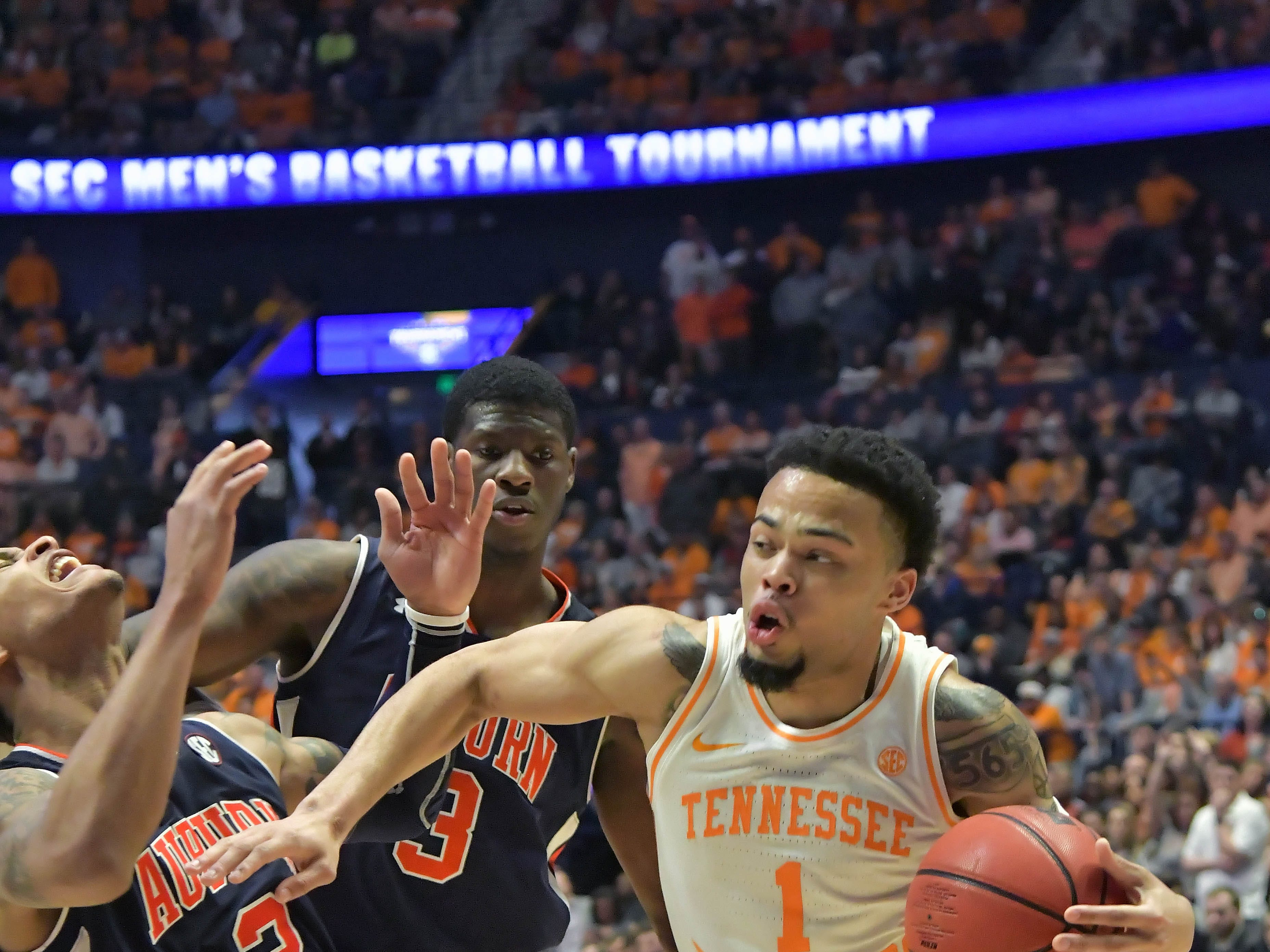Mar 17, 2019; Nashville, TN, USA; Tennessee Volunteers guard Lamonte Turner (1) drives against Auburn Tigers guard Bryce Brown (2) during the second half of the championship game in the SEC conference tournament at Bridgestone Arena. Auburn won 84-64. Mandatory Credit: Jim Brown-USA TODAY Sports