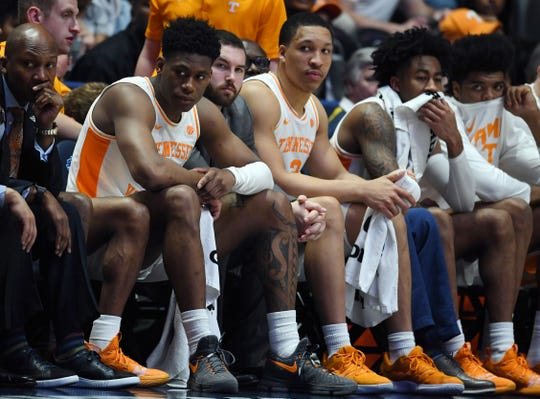 Tennessee guard Admiral Schofield (5) and forward Grant Williams (2) watch from the bench late in a loss to Auburn in the SEC Tournament championship game March 17 at Bridgestone Arena.