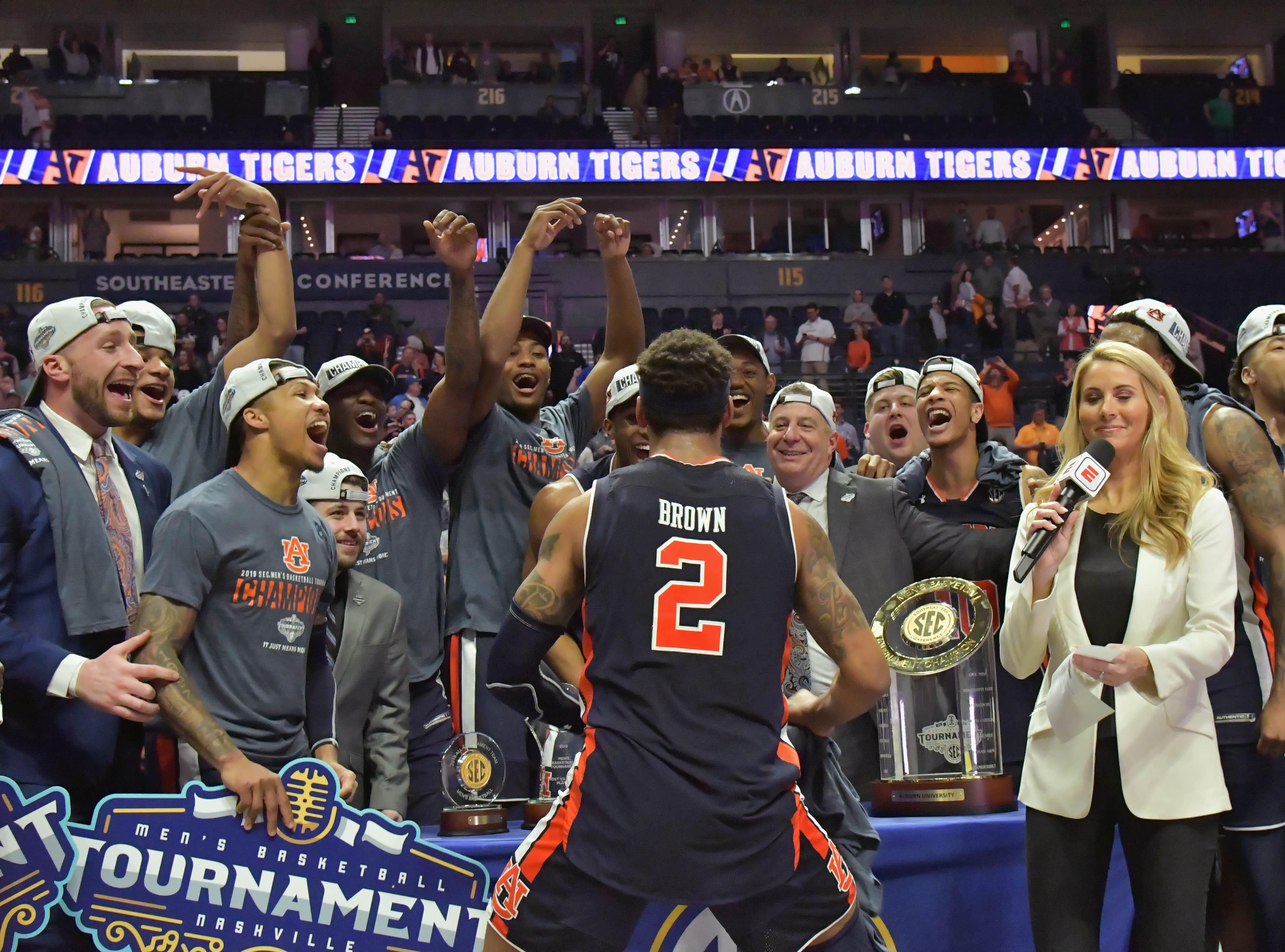 Mar 17, 2019; Nashville, TN, USA; Auburn Tigers guard Bryce Brown (2) jumps up onto the platform to join his teammates and Auburn head coach Bruce Pearl prior to the trophy presentation following the championship game between the Tennessee Volunteers and the Auburn Tigers  in the SEC conference tournament at Bridgestone Arena. Auburn won 84-64. Mandatory Credit: Jim Brown-USA TODAY Sports