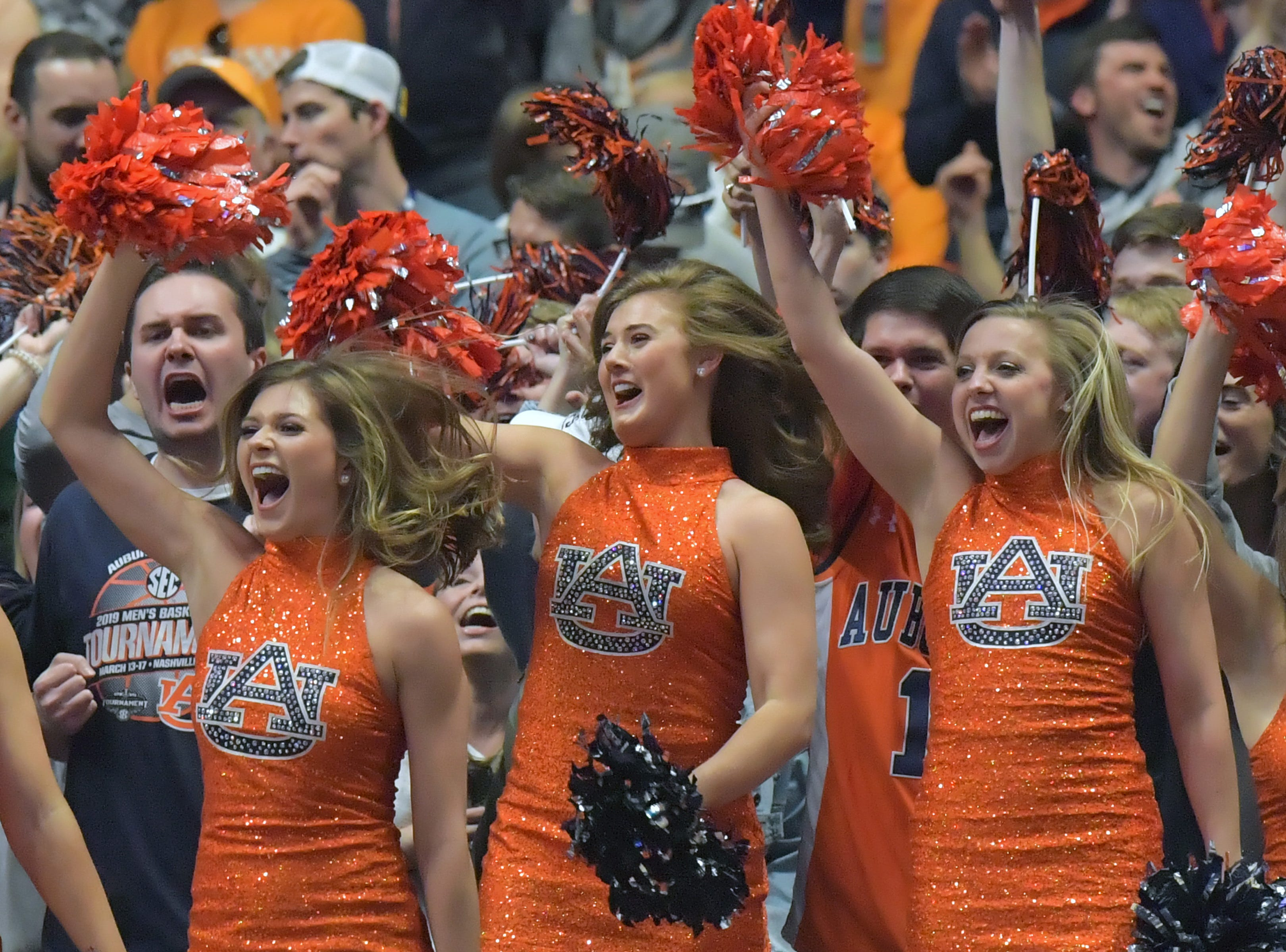 Mar 17, 2019; Nashville, TN, USA; Auburn Tigers dance team members celebrate their team scoring during the second half of the championship game against the Tennessee Volunteers in the SEC conference tournament at Bridgestone Arena. Auburn won 84-64. Mandatory Credit: Jim Brown-USA TODAY Sports