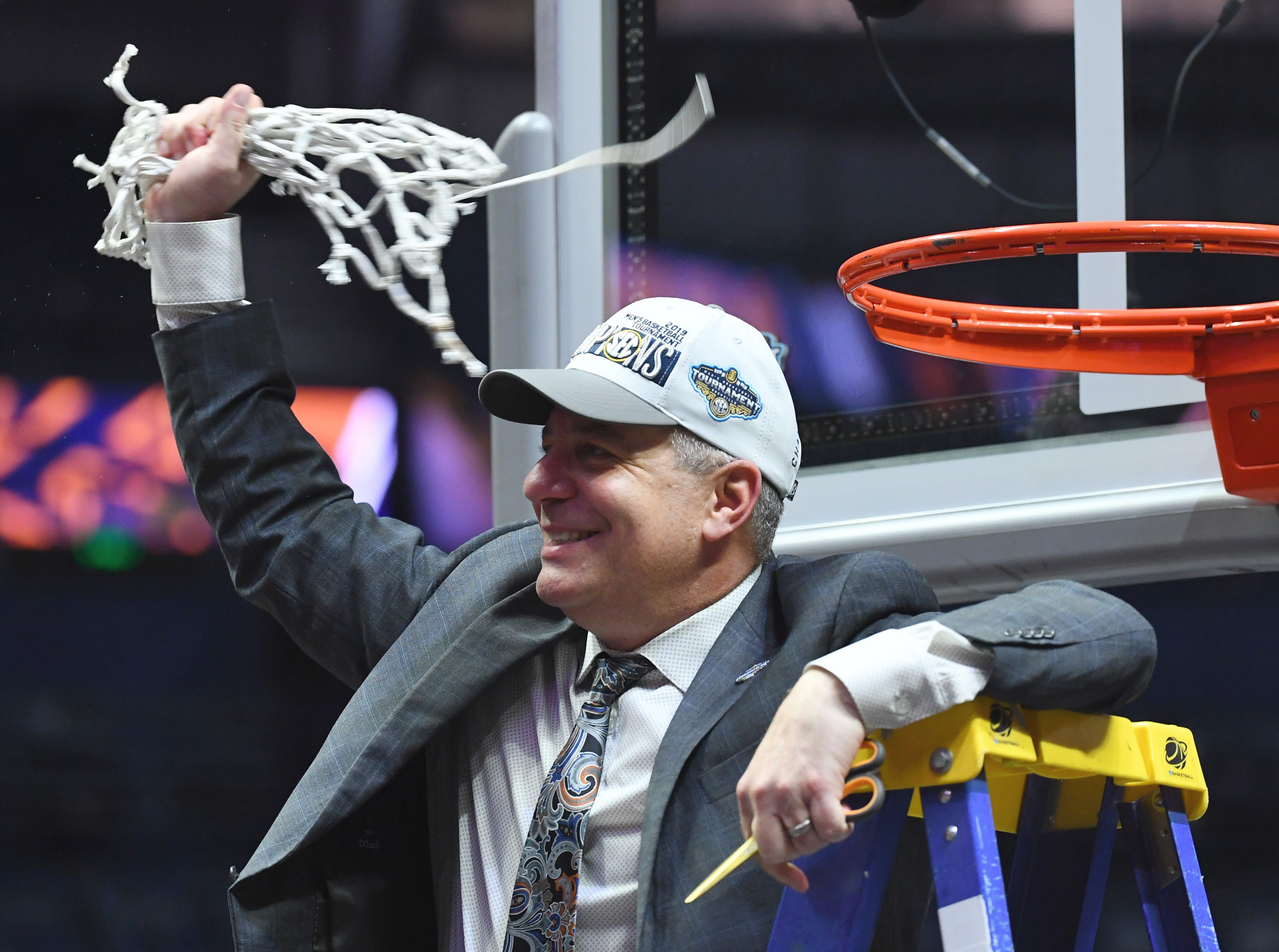 Mar 17, 2019; Nashville, TN, USA; Auburn Tigers head coach Bruce Pearl celebrates as he cuts down the nets after beating the Tennessee Volunteers in the SEC conference tournament championship game at Bridgestone Arena. Mandatory Credit: Christopher Hanewinckel-USA TODAY Sports
