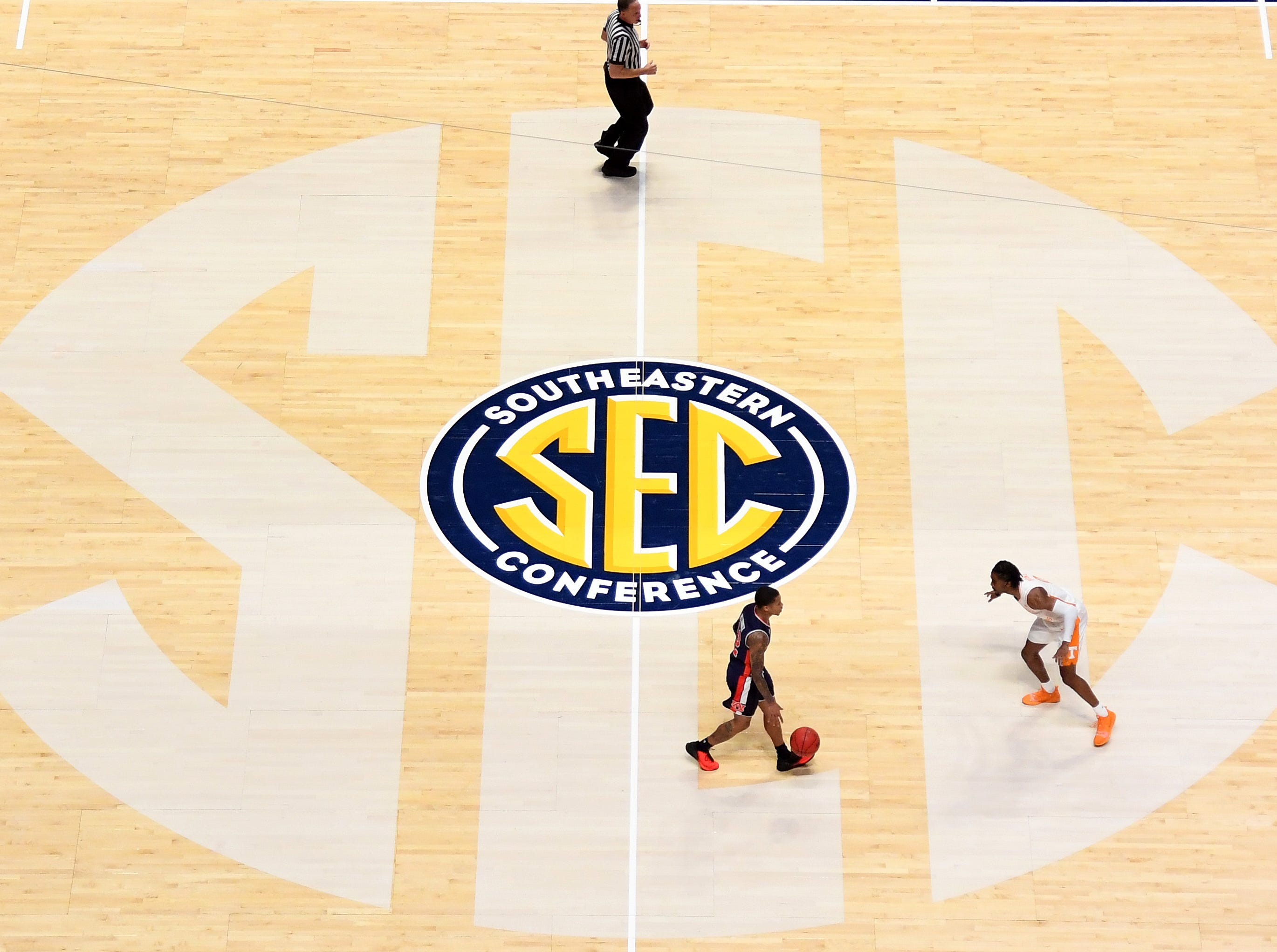 Mar 17, 2019; Nashville, TN, USA; Auburn Tigers guard J'Von McCormick (12) dribbles the ball up the floor against Tennessee Volunteers guard Jordan Bone (0) during the first half in the SEC conference tournament championship game at Bridgestone Arena. Mandatory Credit: Christopher Hanewinckel-USA TODAY Sports