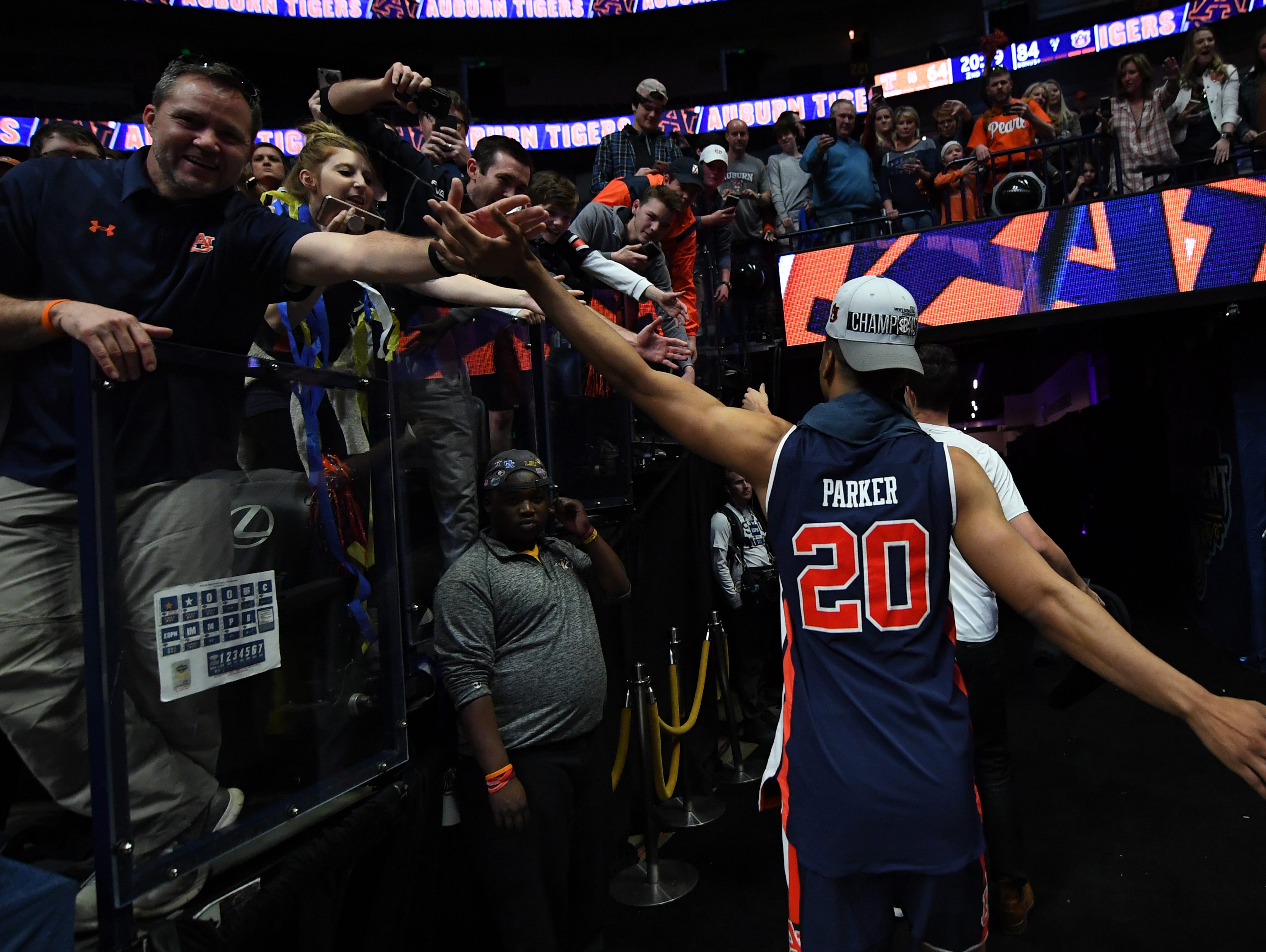 Mar 17, 2019; Nashville, TN, USA; Auburn Tigers forward Myles Parker (20) celebrates with fans as he leaves the court after beating the Tennessee Volunteers in the SEC conference tournament championship game at Bridgestone Arena. Mandatory Credit: Christopher Hanewinckel-USA TODAY Sports