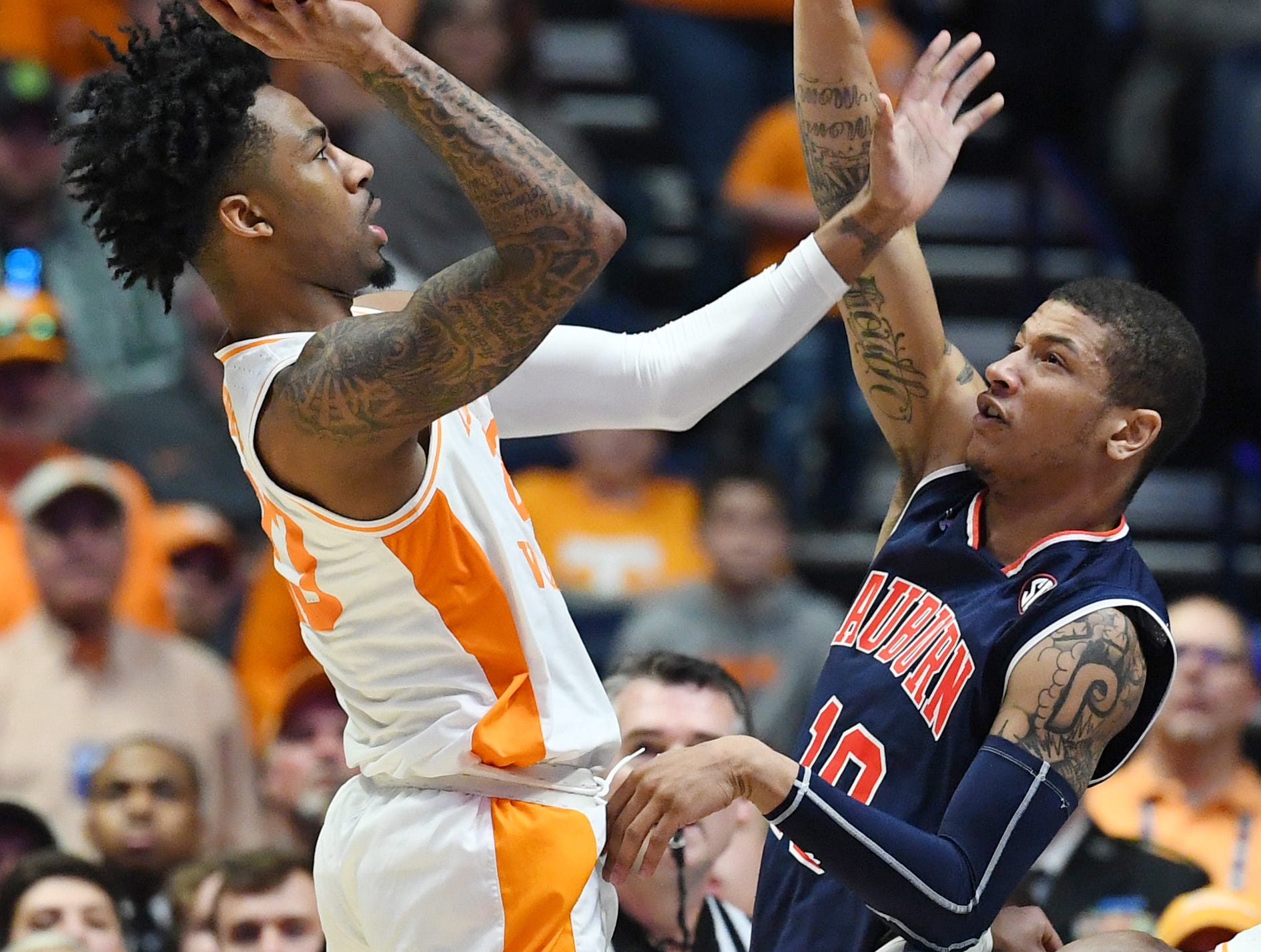 Mar 17, 2019; Nashville, TN, USA; Tennessee Volunteers guard Jordan Bowden (23) shoots over Auburn Tigers guard Samir Doughty (10) during the second half in the SEC conference tournament championship game at Bridgestone Arena. Mandatory Credit: Christopher Hanewinckel-USA TODAY Sports