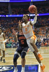 Mar 17, 2019; Nashville, TN, USA; Tennessee Volunteers guard Jordan Bone (0) shoots against Auburn Tigers forward Chuma Okeke (5) during the second half of the championship game in the SEC conference tournament at Bridgestone Arena. Auburn won 84-64. Mandatory Credit: Jim Brown-USA TODAY Sports