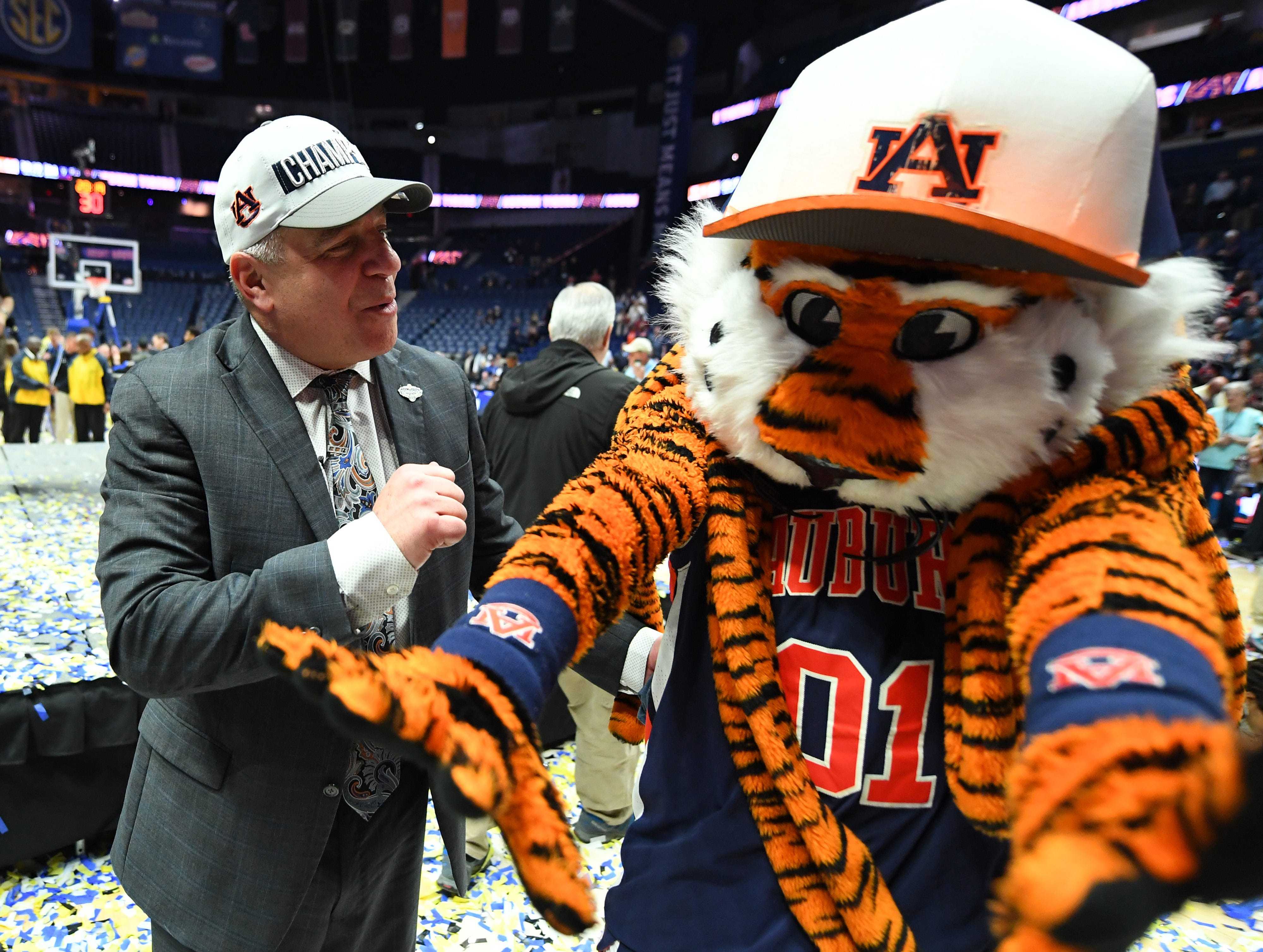 Mar 17, 2019; Nashville, TN, USA; Auburn Tigers head coach Bruce Pearl celebrates with Auburn Tigers mascot Aubie after beating the Tennessee Volunteers in the SEC conference tournament championship game at Bridgestone Arena. Mandatory Credit: Christopher Hanewinckel-USA TODAY Sports