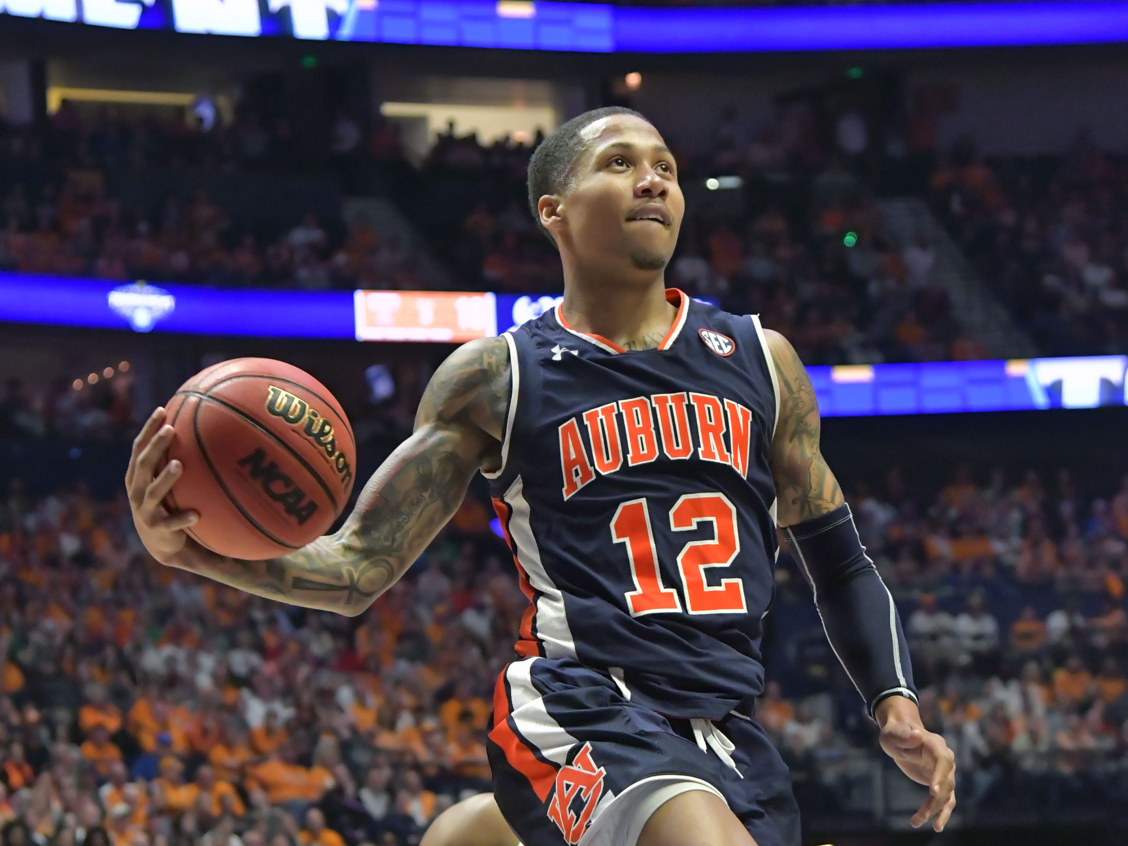 Mar 17, 2019; Nashville, TN, USA; Auburn Tigers guard J'Von McCormick (12) shoots against Tennessee Volunteers during the first half of the championship game in the SEC conference tournament at Bridgestone Arena. Mandatory Credit: Jim Brown-USA TODAY Sports