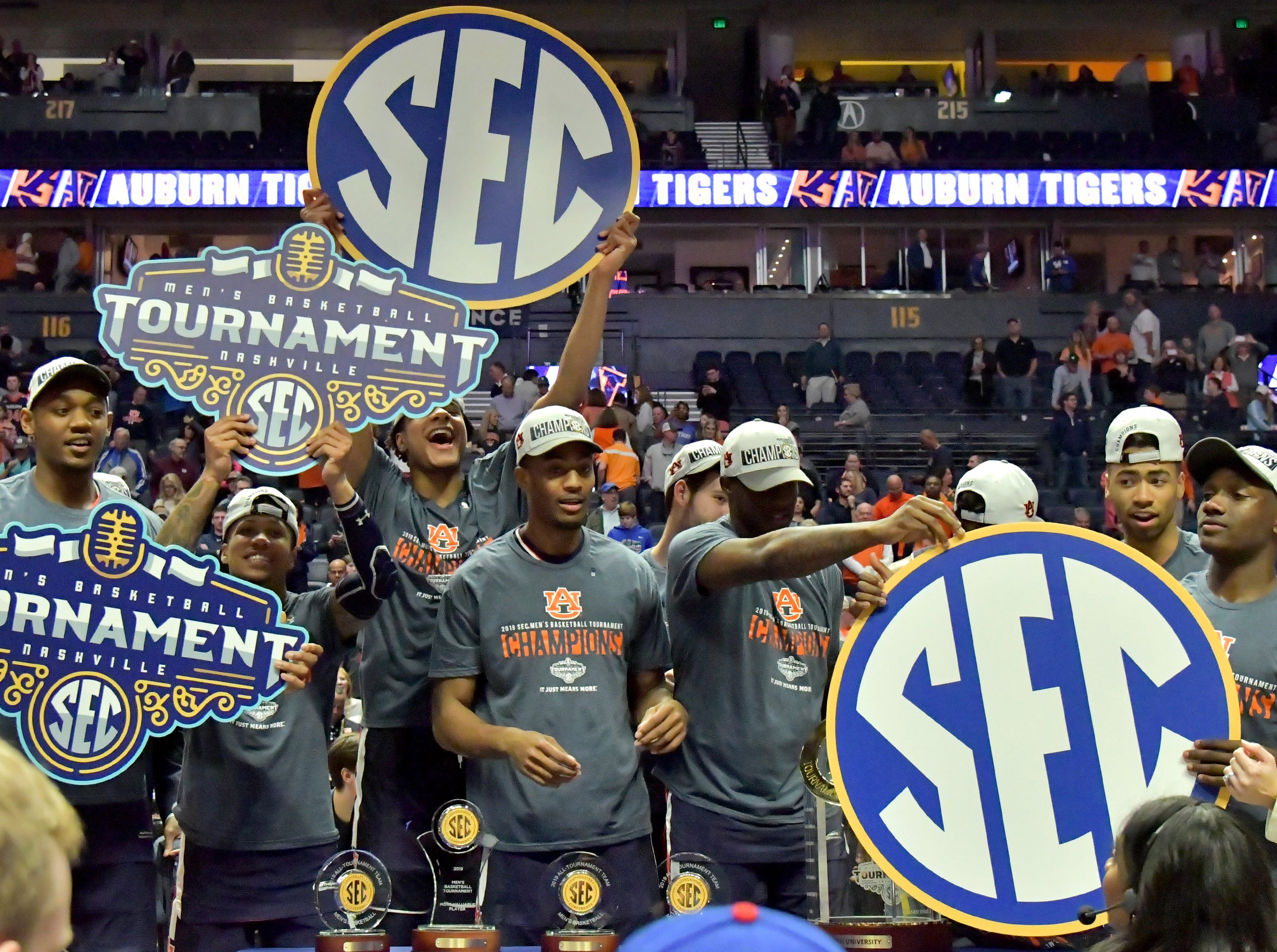 Mar 17, 2019; Nashville, TN, USA; Auburn Tigers teammates celebrate prior to the trophy presentation following the championship game between the Tennessee Volunteers and the Auburn Tigers  in the SEC conference tournament at Bridgestone Arena. Auburn won 84-64. Mandatory Credit: Jim Brown-USA TODAY Sports