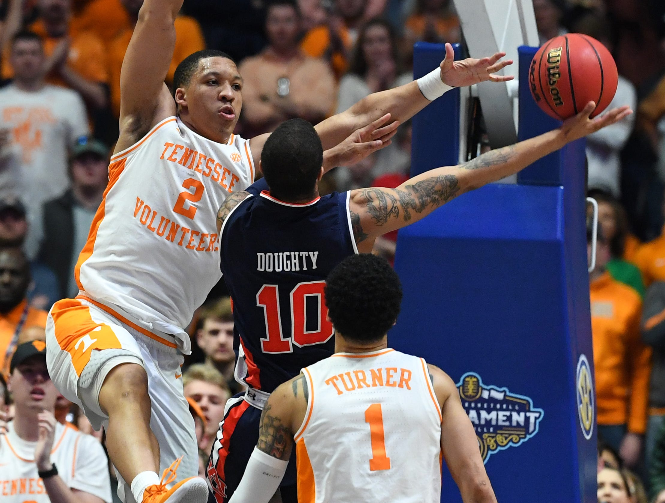 Mar 17, 2019; Nashville, TN, USA; Tennessee Volunteers forward Grant Williams (2) tries to block a shot by Auburn Tigers guard Samir Doughty (10) during the first half in the SEC conference tournament championship game at Bridgestone Arena. Mandatory Credit: Christopher Hanewinckel-USA TODAY Sports