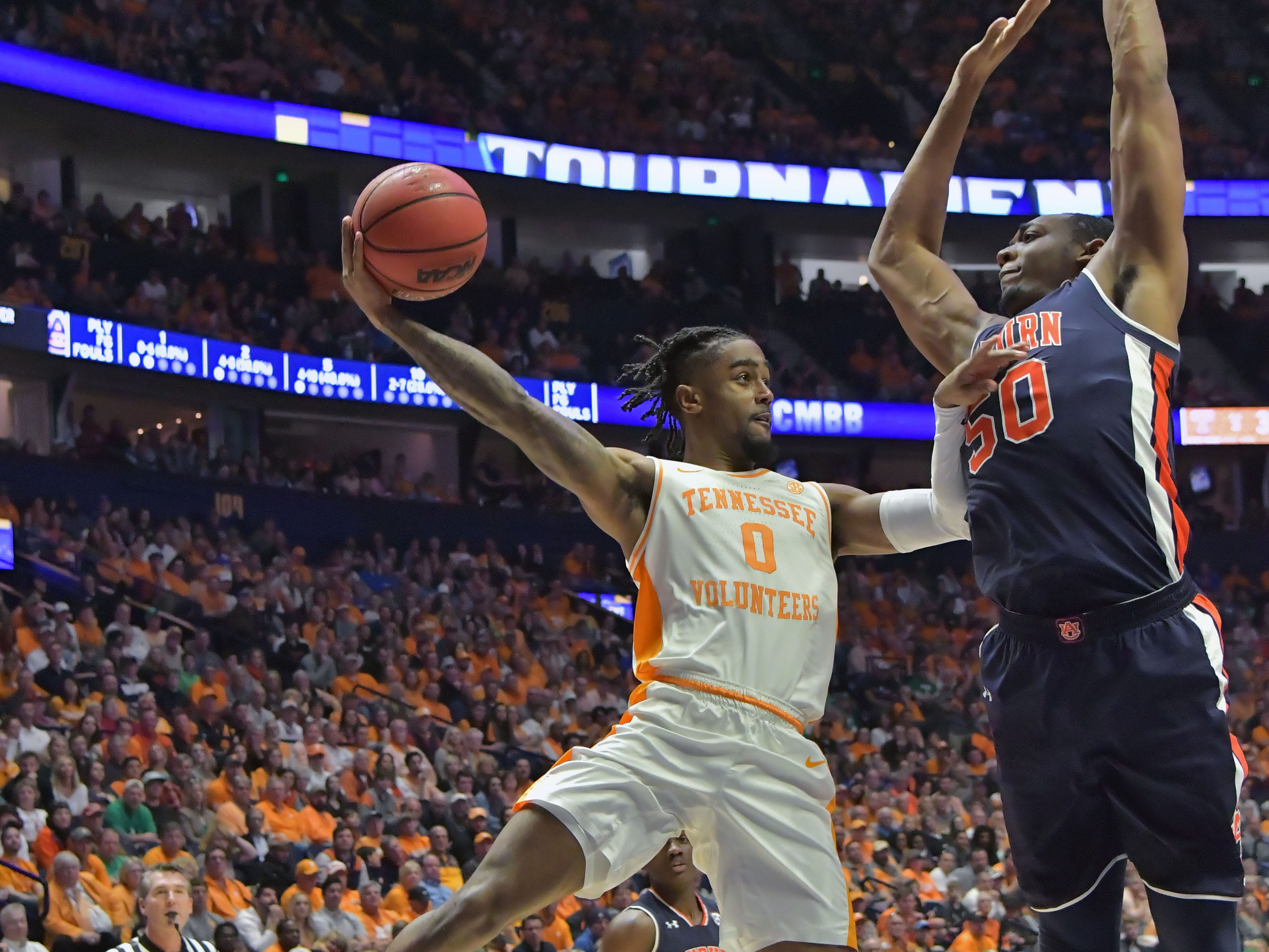 Mar 17, 2019; Nashville, TN, USA; Tennessee Volunteers guard Jordan Bone (0) passes against Auburn Tigers center Austin Wiley (50) during the second half of the championship game in the SEC conference tournament at Bridgestone Arena. Auburn won 84-64. Mandatory Credit: Jim Brown-USA TODAY Sports