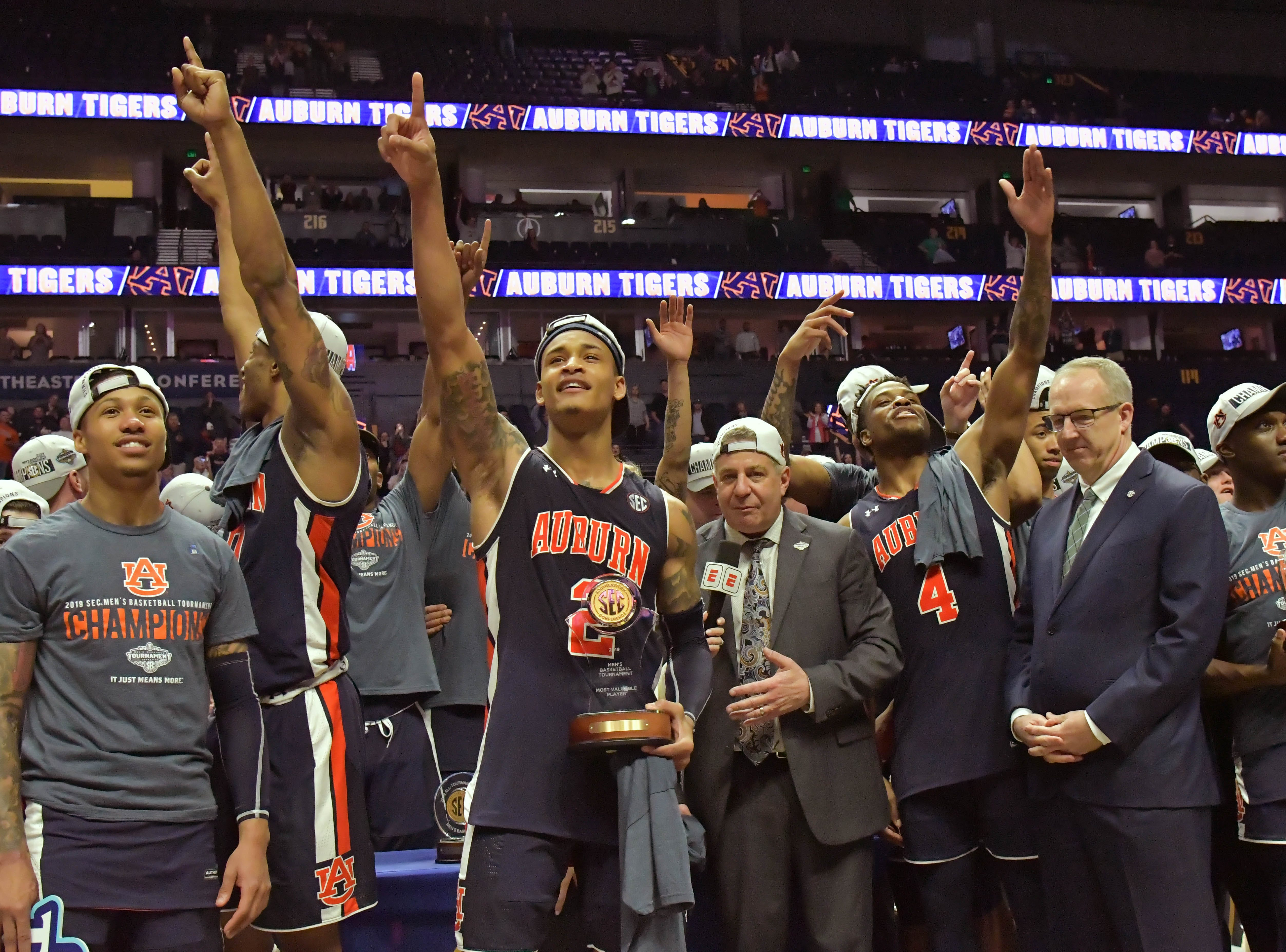 Mar 17, 2019; Nashville, TN, USA;  Auburn Tigers celebrate defeating the Tennessee Volunteers following the championship game in the SEC conference tournament at Bridgestone Arena. Auburn won 84-64. Mandatory Credit: Jim Brown-USA TODAY Sports