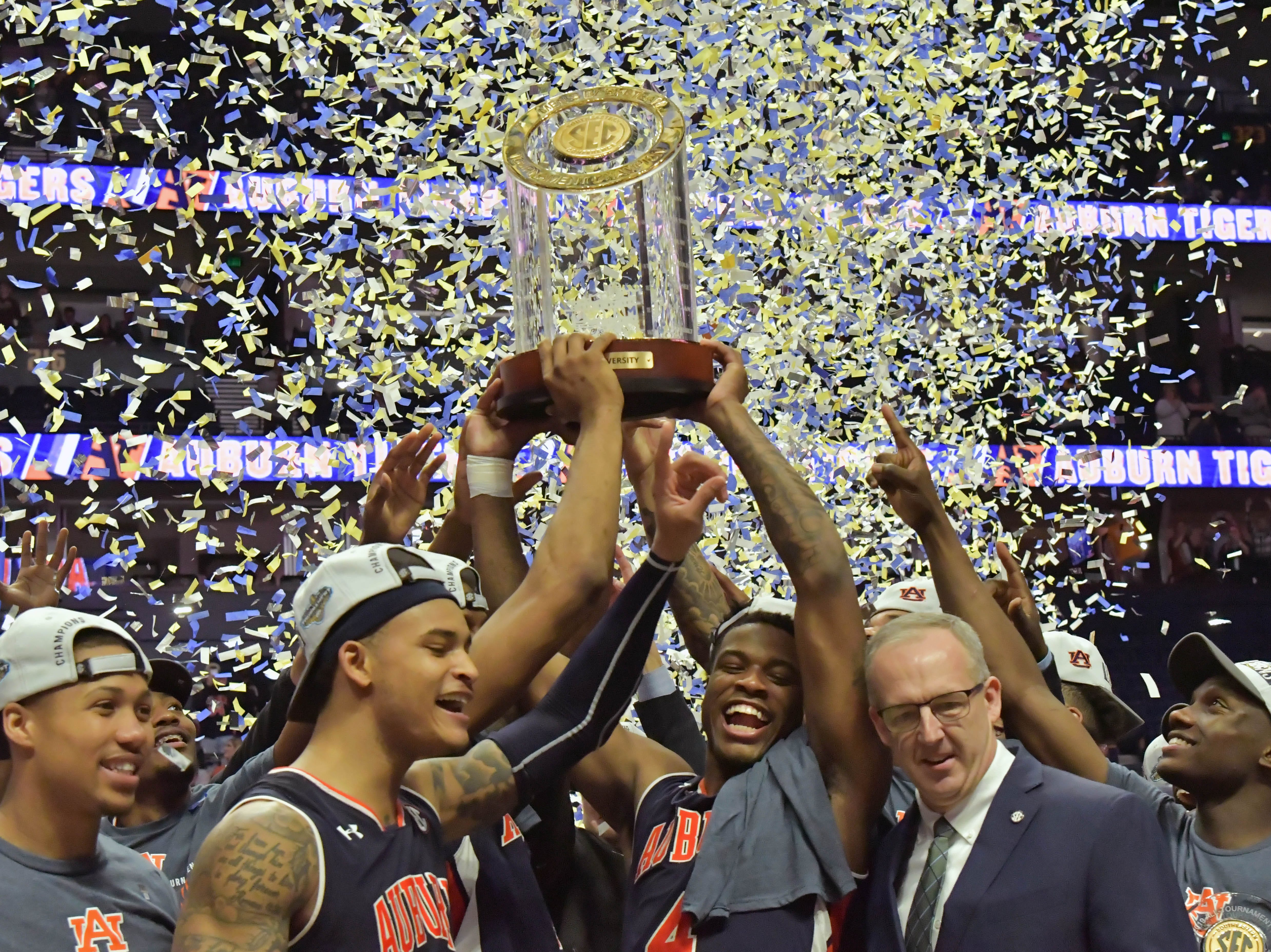 Mar 17, 2019; Nashville, TN, USA; Auburn Tigers celebrate after defeating the Tennessee Volunteers in the  championship game of the SEC conference tournament at Bridgestone Arena. Auburn won 84-64. Mandatory Credit: Jim Brown-USA TODAY Sports