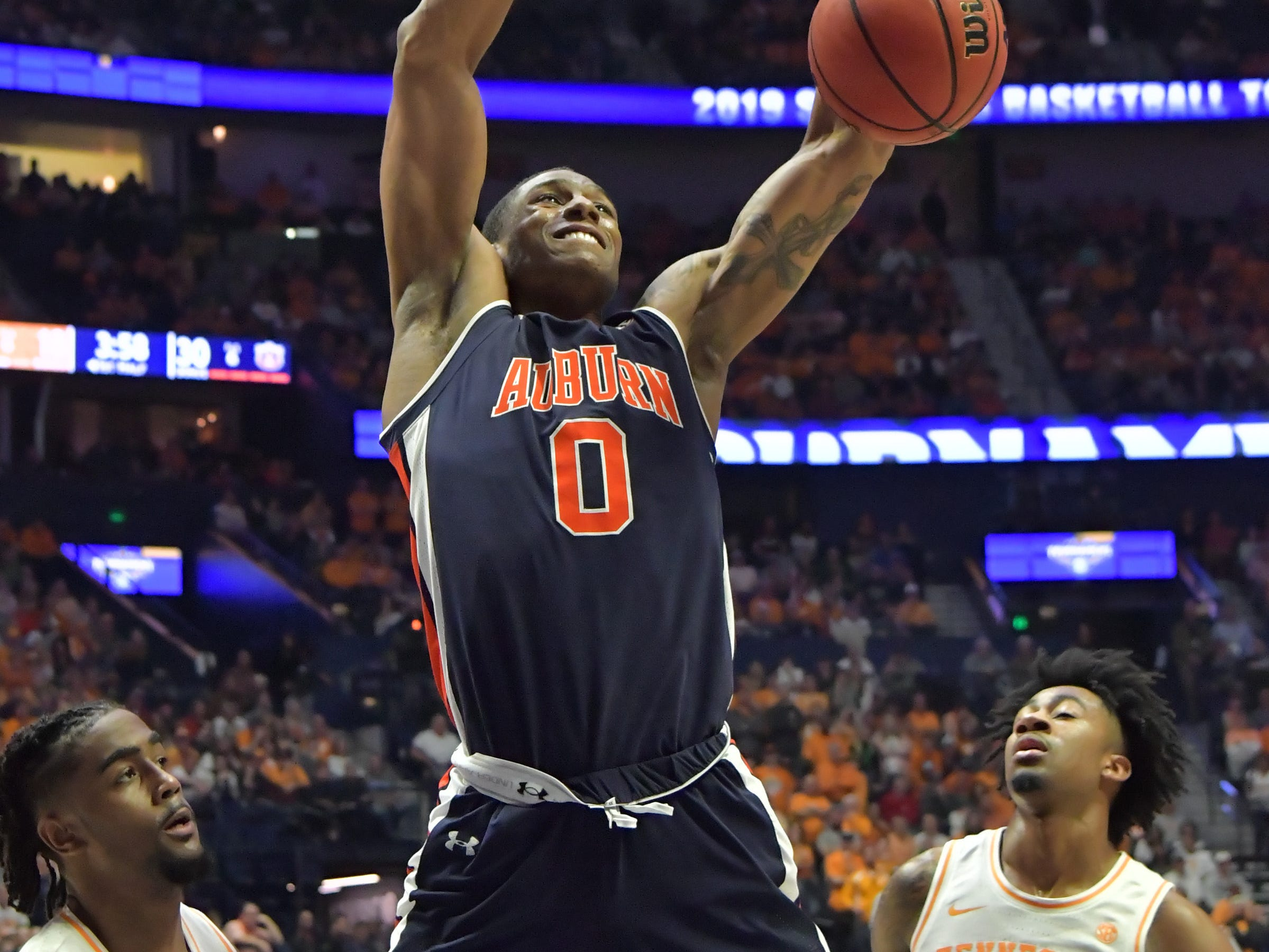 Mar 17, 2019; Nashville, TN, USA; Auburn Tigers forward Horace Spencer (0) loses the ball against Tennessee Volunteers guard Jordan Bone (0) and guard Jordan Bowden (23) during the first half of the championship game in the SEC conference tournament at Bridgestone Arena. Mandatory Credit: Jim Brown-USA TODAY Sports