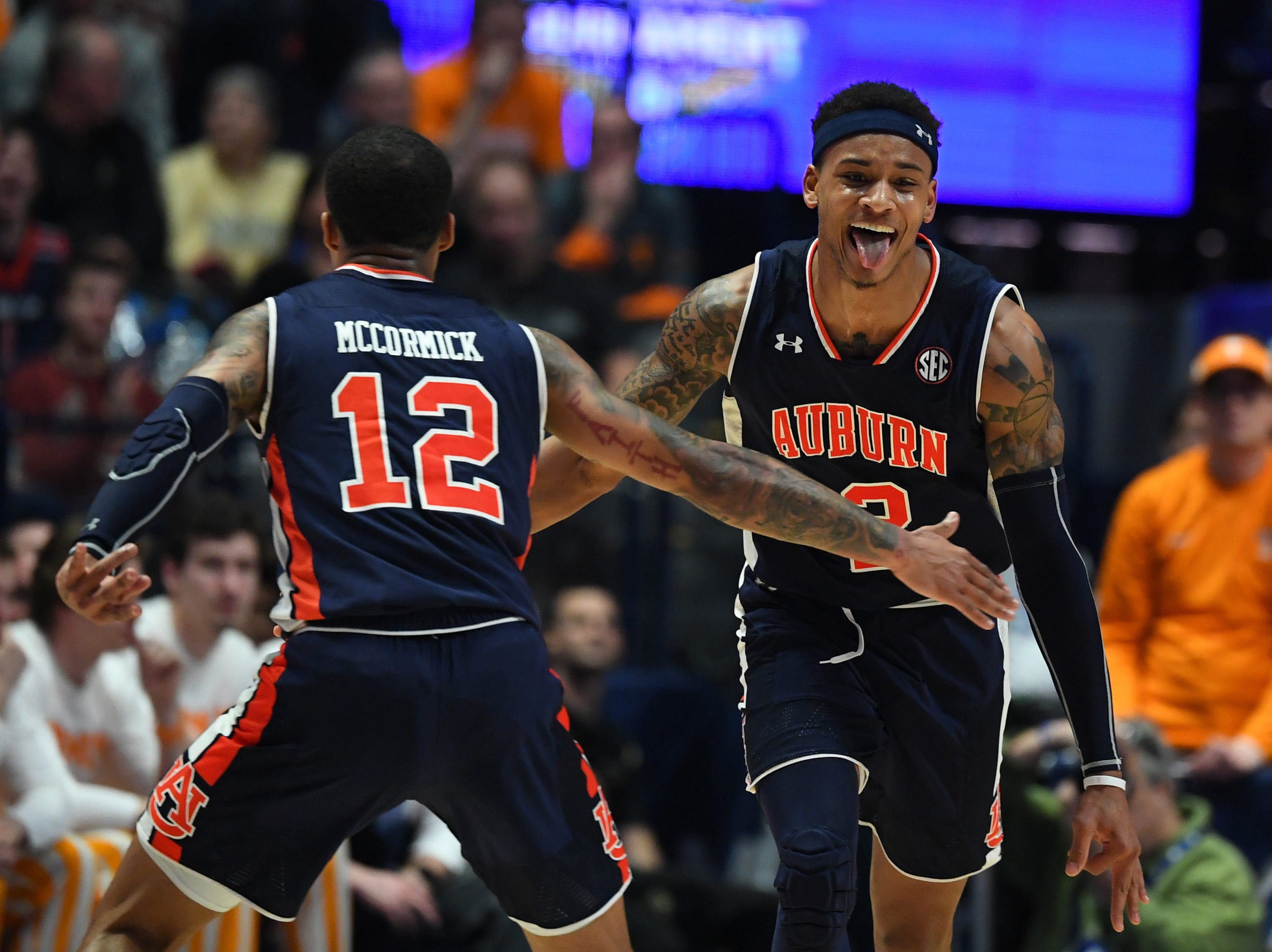Mar 17, 2019; Nashville, TN, USA; Auburn Tigers guard Bryce Brown (2) and Auburn Tigers guard J'Von McCormick (12) celebrate after a basket during the first half against the Tennessee Volunteers  in the SEC conference tournament championship game at Bridgestone Arena. Mandatory Credit: Christopher Hanewinckel-USA TODAY Sports