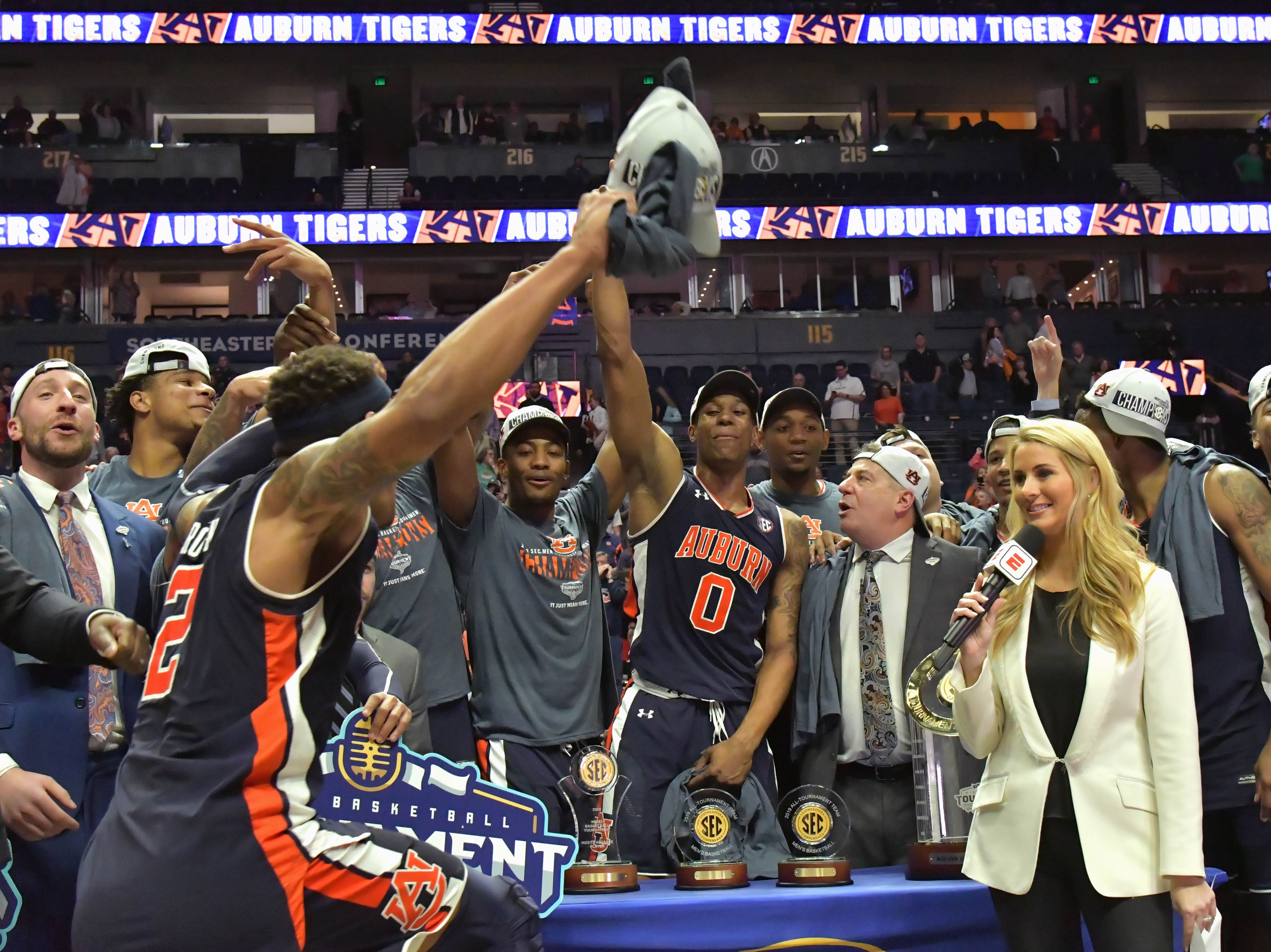 Mar 17, 2019; Nashville, TN, USA; Auburn Tigers guard Bryce Brown (2) celebrates with his teammates and Auburn head coach Bruce Pearl prior to the trophy presentation following the championship game between the Tennessee Volunteers and the Auburn Tigers  in the SEC conference tournament at Bridgestone Arena. Auburn won 84-64. Mandatory Credit: Jim Brown-USA TODAY Sports