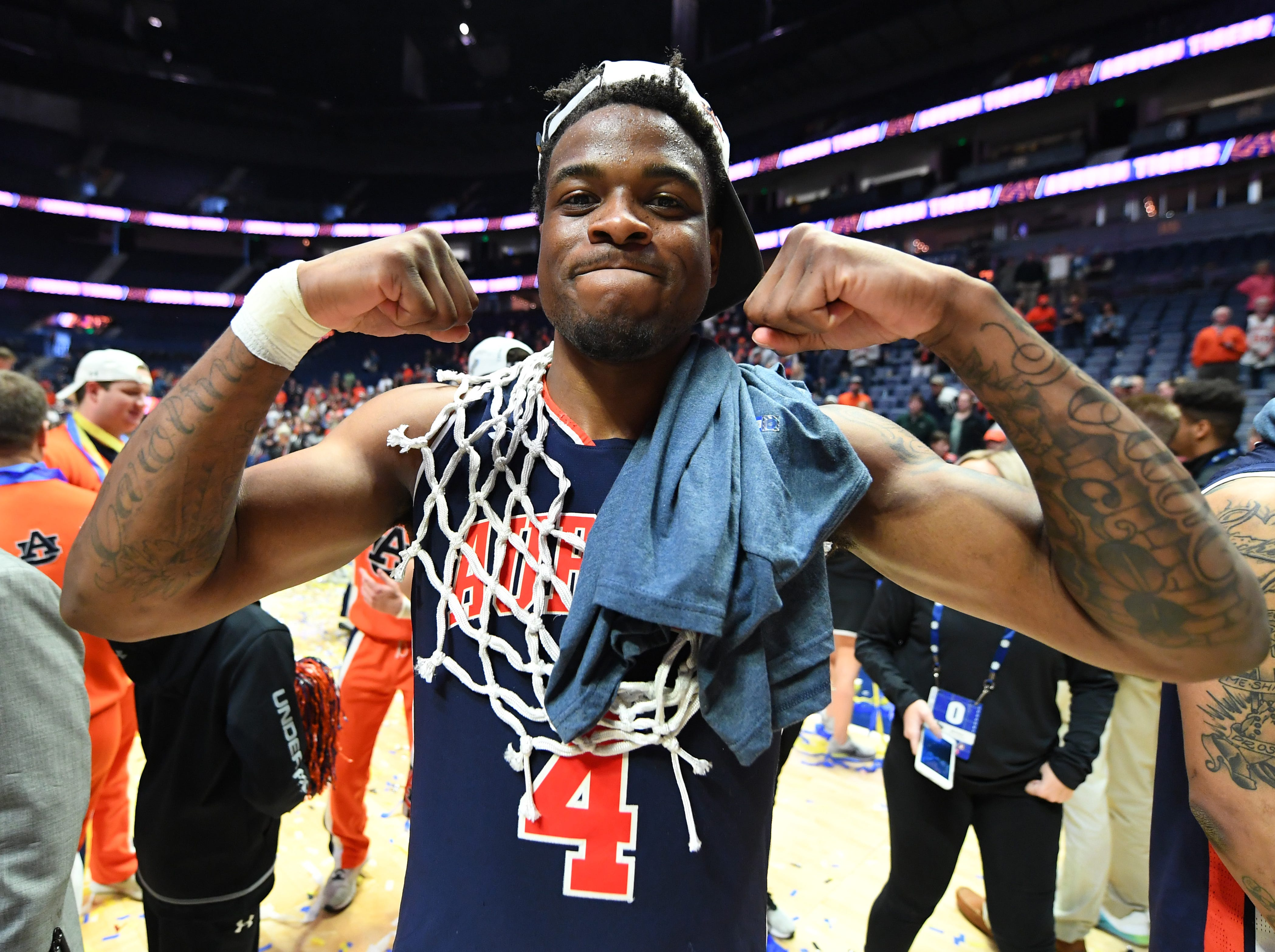 Mar 17, 2019; Nashville, TN, USA; Auburn Tigers guard Malik Dunbar (4) celebrates after beating the Tennessee Volunteers in the SEC conference tournament championship game at Bridgestone Arena. Mandatory Credit: Christopher Hanewinckel-USA TODAY Sports
