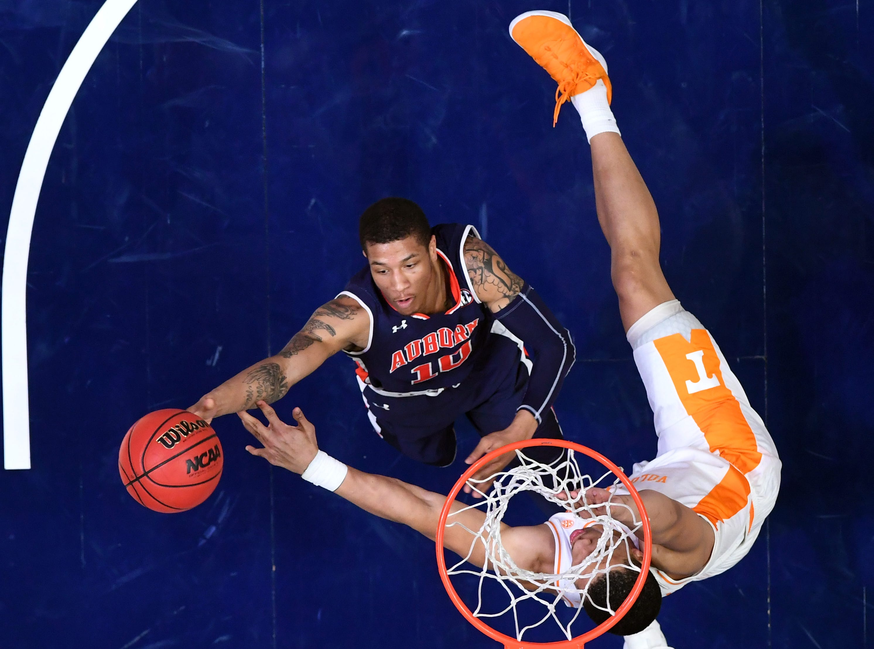 Mar 17, 2019; Nashville, TN, USA; Auburn Tigers guard Samir Doughty (10) shoots over Tennessee Volunteers forward Grant Williams (2) in the SEC conference tournament championship game at Bridgestone Arena. Mandatory Credit: Christopher Hanewinckel-USA TODAY Sports