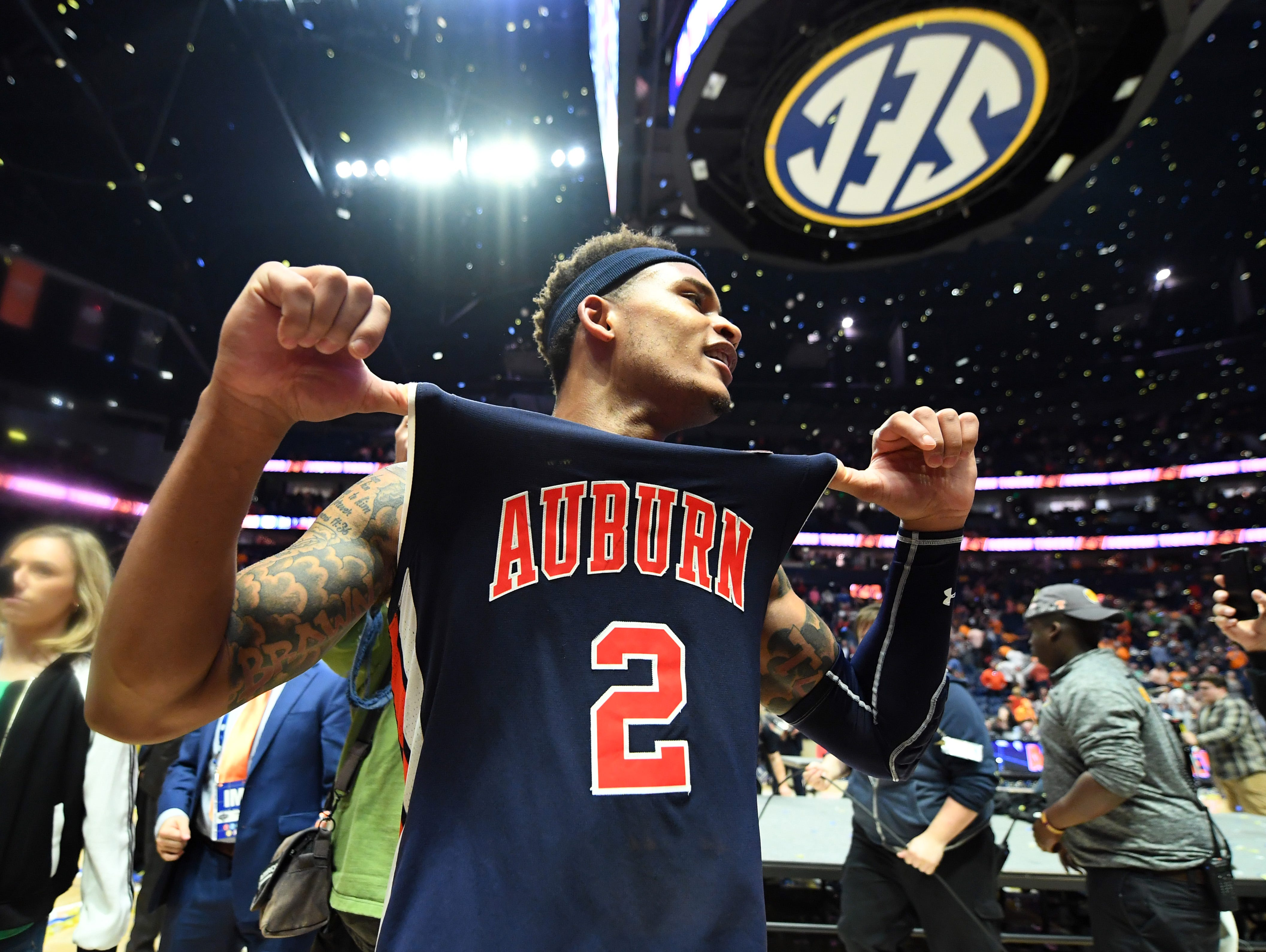 Mar 17, 2019; Nashville, TN, USA; Auburn Tigers guard Bryce Brown (2) celebrates after beating the Tennessee Volunteers in the SEC conference tournament championship game at Bridgestone Arena. Mandatory Credit: Christopher Hanewinckel-USA TODAY Sports