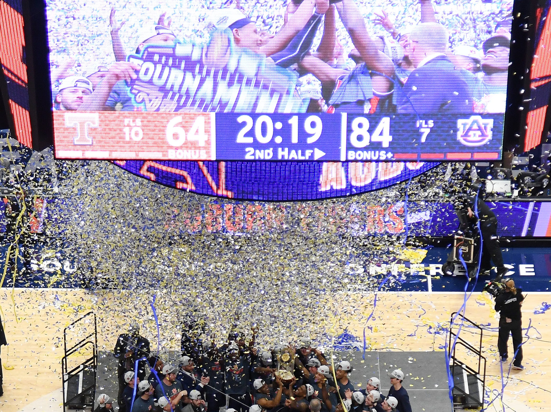 Mar 17, 2019; Nashville, TN, USA; Auburn Tigers players celebrate after beating the Tennessee Volunteers in the SEC conference tournament championship game at Bridgestone Arena. Mandatory Credit: Christopher Hanewinckel-USA TODAY Sports