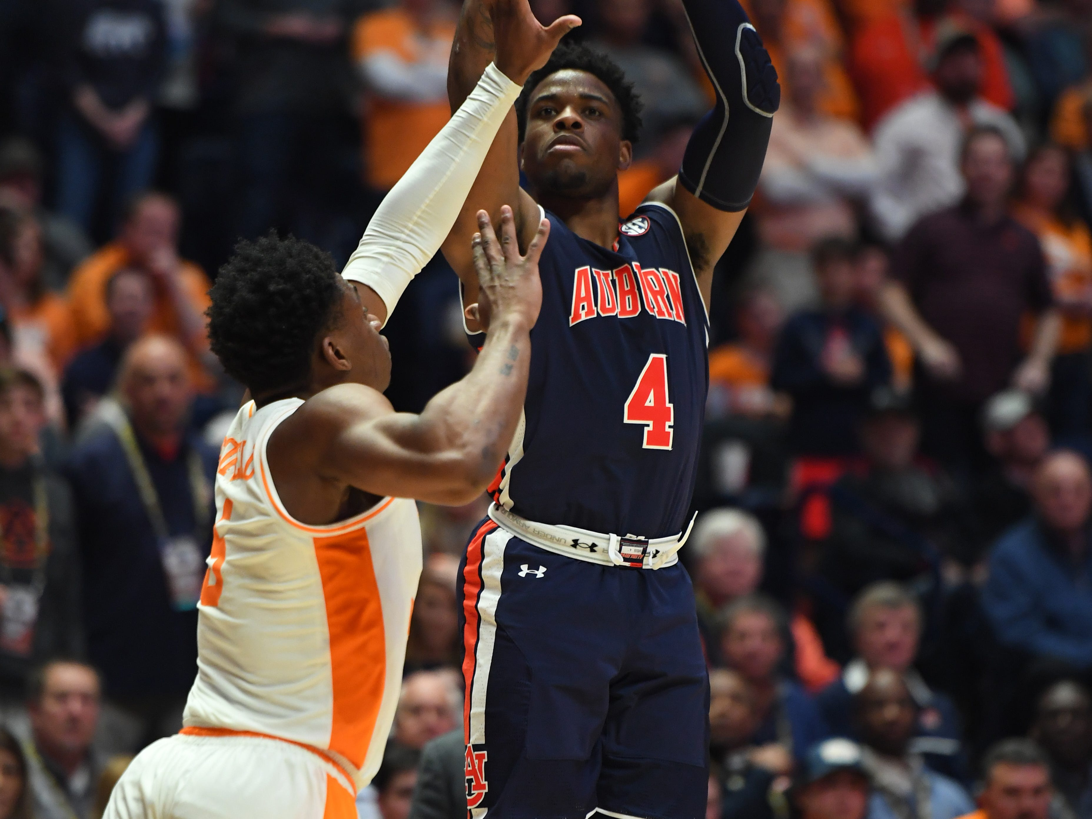 Mar 17, 2019; Nashville, TN, USA; Auburn Tigers guard Malik Dunbar (4) shoots the ball over Tennessee Volunteers guard Admiral Schofield (5) during the second half in the SEC conference tournament championship game at Bridgestone Arena. Mandatory Credit: Christopher Hanewinckel-USA TODAY Sports