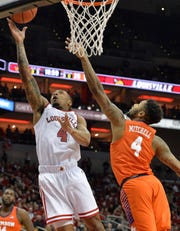 Louisville guard Khwan Fore (4) goes in for a layup past the defense of Clemson guard Shelton Mitchell (4) during the second half of an NCAA college basketball game in Louisville, Ky., Saturday, Feb. 16, 2019. Louisville won 56-55. (AP Photo/Timothy D. Easley)