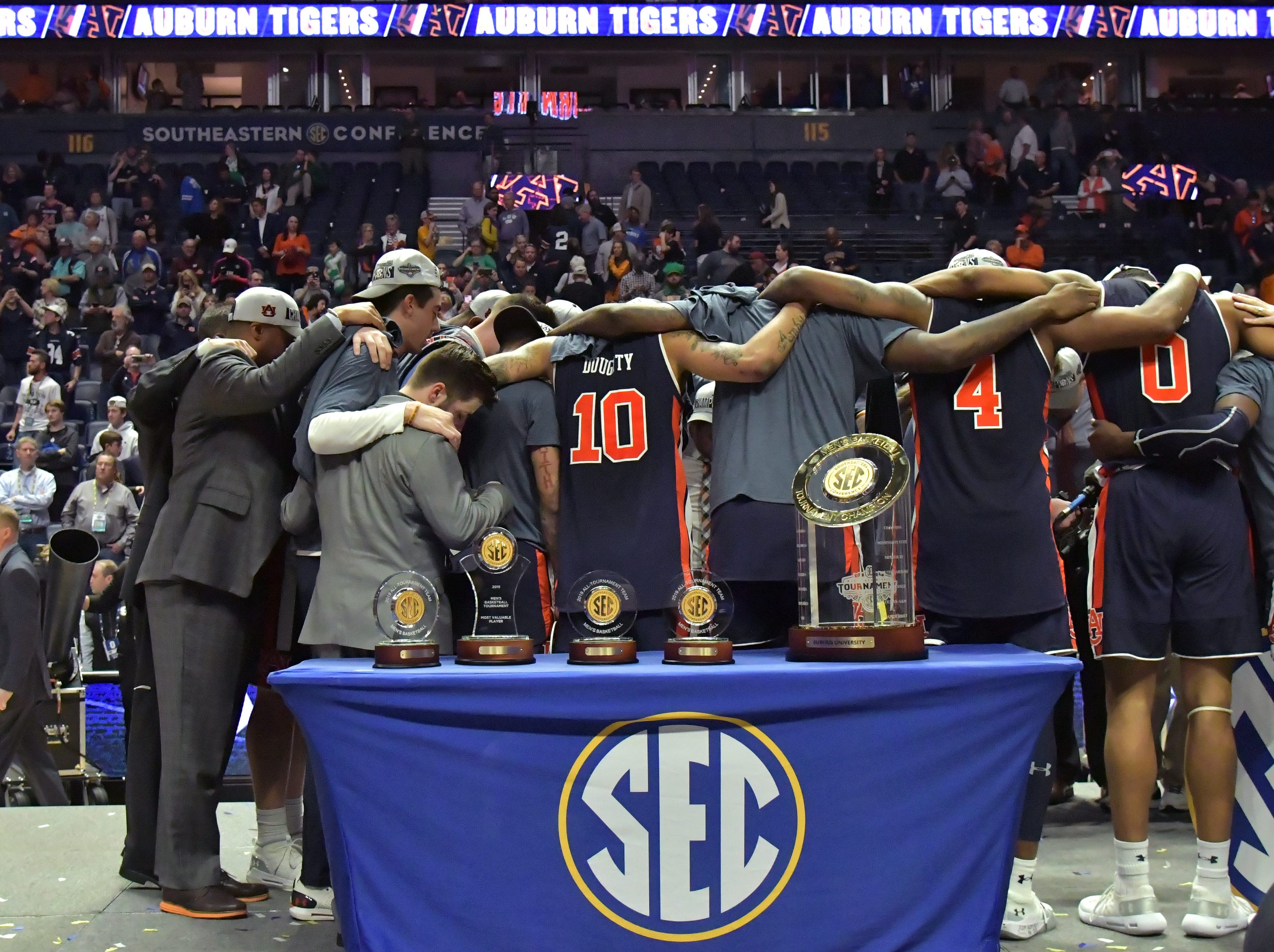 Mar 17, 2019; Nashville, TN, USA; Auburn Tigers teammates gather together prior to the trophy presentation following the championship game between the Tennessee Volunteers and the Auburn Tigers  in the SEC conference tournament at Bridgestone Arena. Auburn won 84-64. Mandatory Credit: Jim Brown-USA TODAY Sports