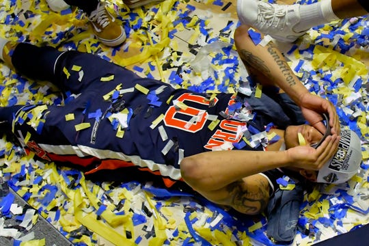 Auburn guard Samir Doughty (10) is covered in confetti as he lies on the playing floor following the SEC Tournament championship game against Tennessee on March 18, 2019, in Nashville, Tennessee.