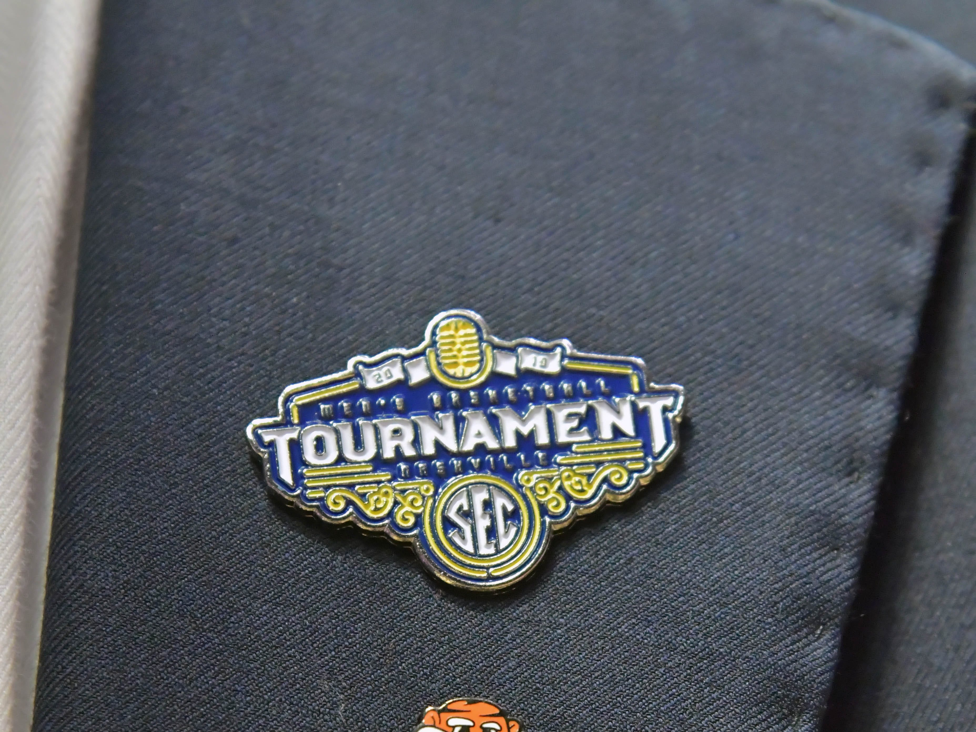 Mar 17, 2019; Nashville, TN, USA; Lapel pins worn by Auburn alumni and former NBA Dallas Mavericks player Marquis Daniels  (center) during the championship game between the Tennessee Volunteers and the Auburn Tigers  in the SEC conference tournament at Bridgestone Arena. Auburn won 84-64. Mandatory Credit: Jim Brown-USA TODAY Sports