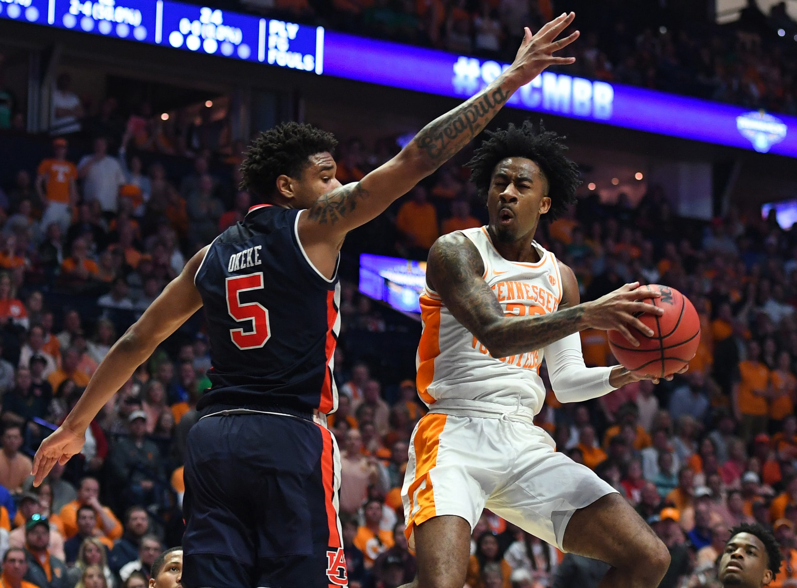 Mar 17, 2019; Nashville, TN, USA; Tennessee Volunteers guard Jordan Bowden (23) makes a shot around Auburn Tigers forward Chuma Okeke (5) to end the first half in the SEC conference tournament championship game at Bridgestone Arena. Mandatory Credit: Christopher Hanewinckel-USA TODAY Sports