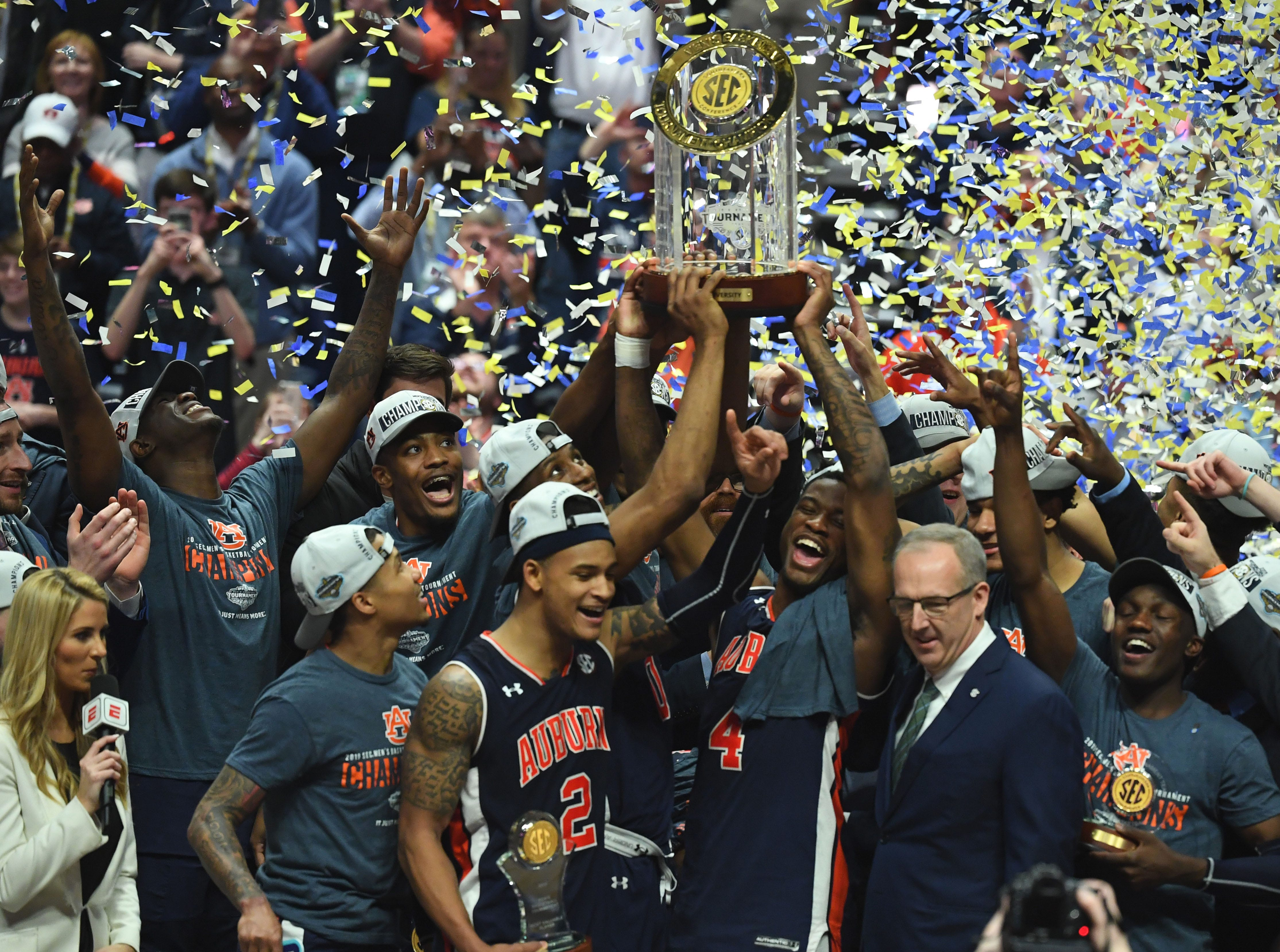 Mar 17, 2019; Nashville, TN, USA; Auburn Tigers celebrates after beating the Tennessee Volunteers in the SEC conference tournament championship game at Bridgestone Arena. Mandatory Credit: Christopher Hanewinckel-USA TODAY Sports