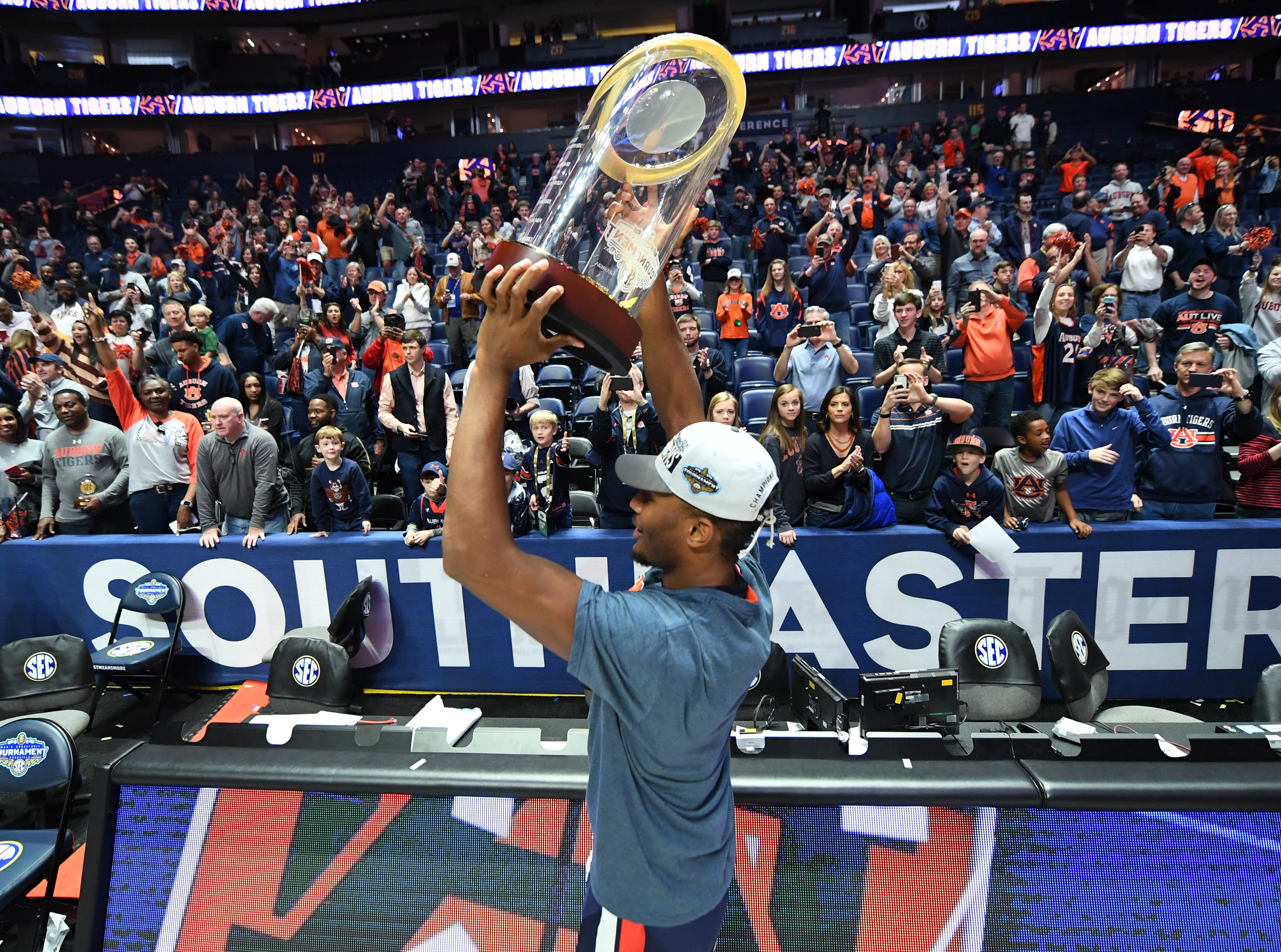 Mar 17, 2019; Nashville, TN, USA; Auburn Tigers forward Anfernee McLemore (24) celebrates with the crowd after beating the Tennessee Volunteers in the SEC conference tournament championship game at Bridgestone Arena. Mandatory Credit: Christopher Hanewinckel-USA TODAY Sports