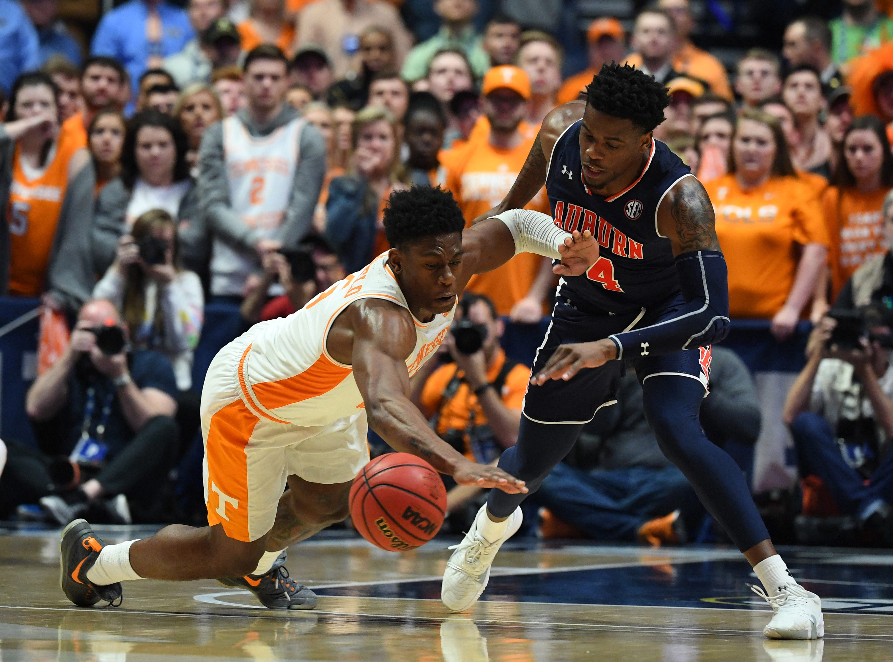 Mar 17, 2019; Nashville, TN, USA; Tennessee Volunteers guard Admiral Schofield (5) dives for a loose ball against Auburn Tigers guard Malik Dunbar (4) during the second half in the SEC conference tournament championship game at Bridgestone Arena. Mandatory Credit: Christopher Hanewinckel-USA TODAY Sports