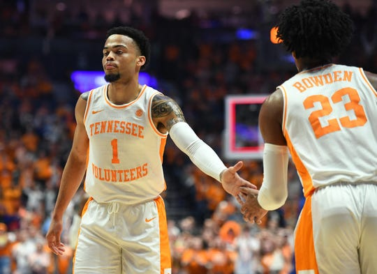 Mar 17, 2019; Nashville, TN, USA; Tennessee Volunteers guard Lamonte Turner (1) and Tennessee Volunteers guard Jordan Bowden (23) after a basket to end the first half against the Auburn Tigers in the SEC conference tournament championship game at Bridgestone Arena. Mandatory Credit: Christopher Hanewinckel-USA TODAY Sports