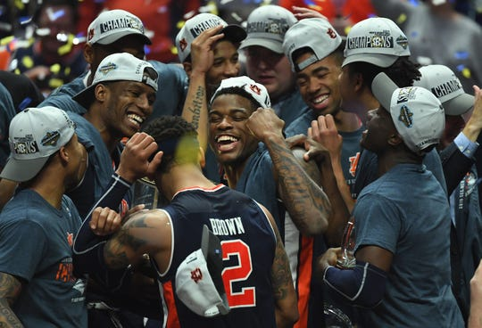 Mar 17, 2019; Nashville, TN, USA; Auburn Tigers guard Malik Dunbar (4) celebrates with teammates after beating the Tennessee Volunteers  in the SEC conference tournament championship game at Bridgestone Arena. Mandatory Credit: Christopher Hanewinckel-USA TODAY Sports