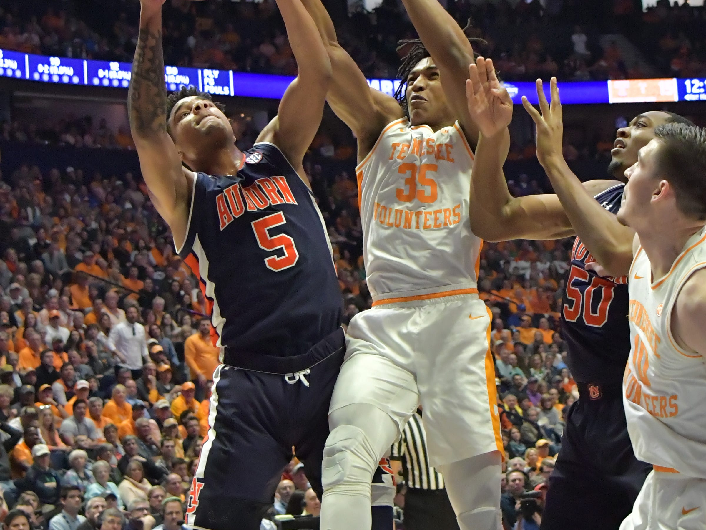 Mar 17, 2019; Nashville, TN, USA; Auburn Tigers forward Chuma Okeke (5) goes for the rebound againstTennessee Volunteers forward Yves Pons (35) during the first half of the championship game in the SEC conference tournament at Bridgestone Arena. Mandatory Credit: Jim Brown-USA TODAY Sports