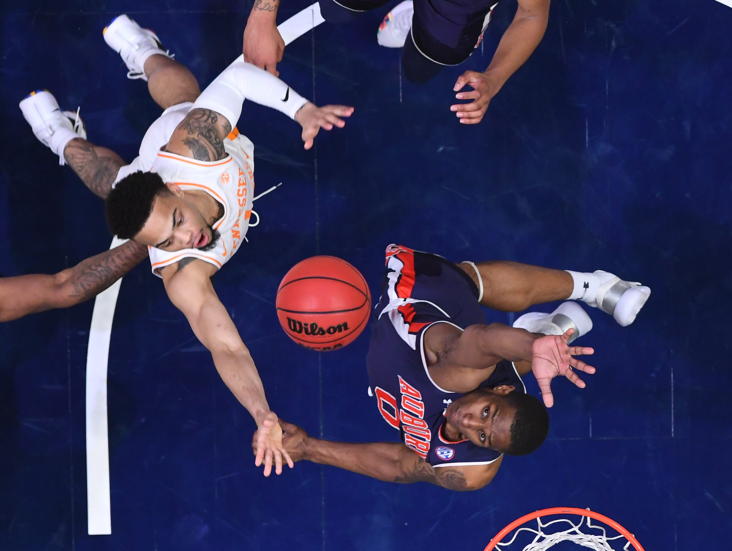 Mar 17, 2019; Nashville, TN, USA; Tennessee Volunteers guard Lamonte Turner (1) shoots over a block attempt from Auburn Tigers forward Horace Spencer (0) in the SEC conference tournament championship game at Bridgestone Arena. Mandatory Credit: Christopher Hanewinckel-USA TODAY Sports